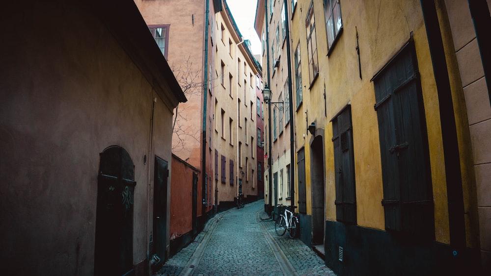 alleyway between village houses during daytime