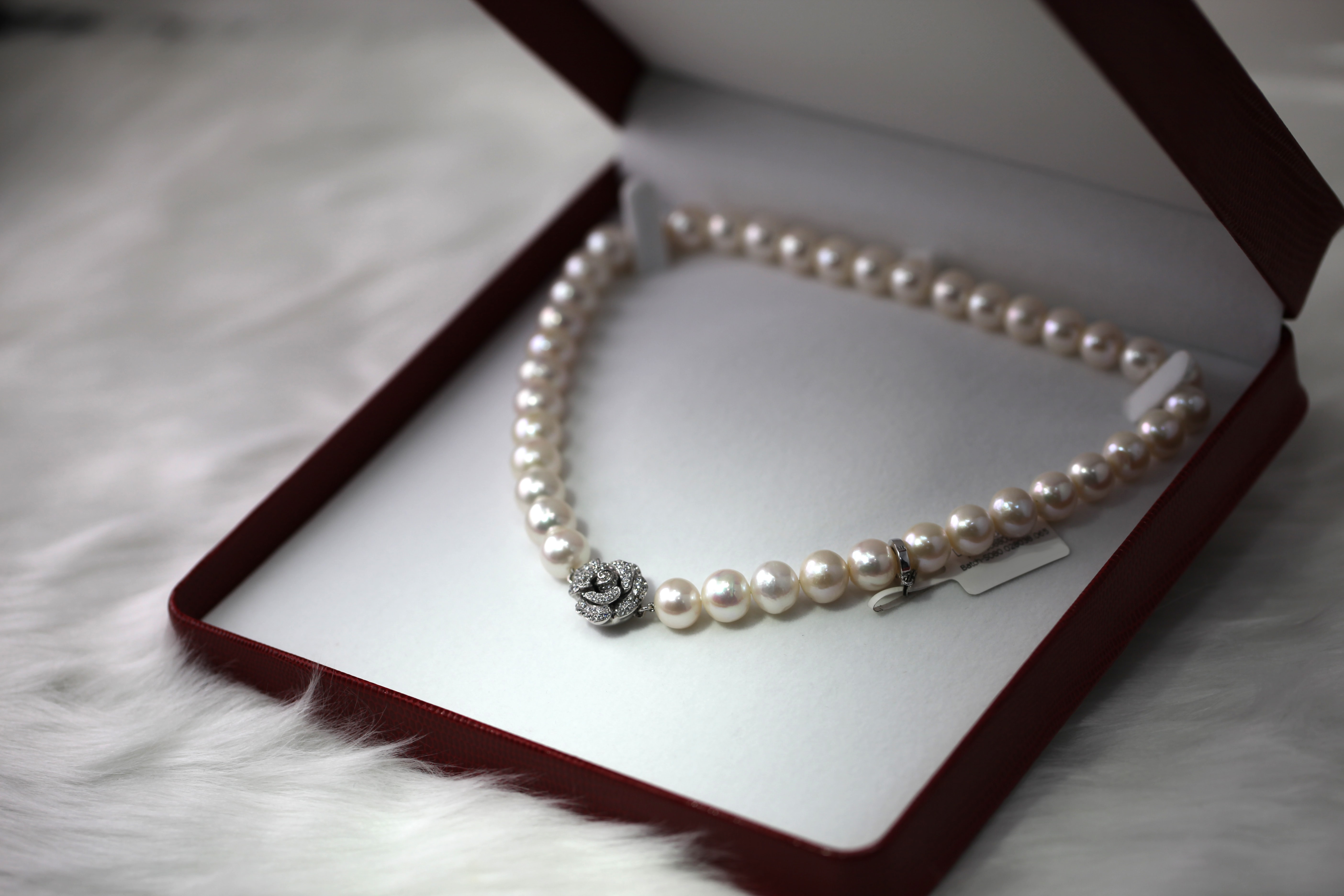 white pearl necklace with box