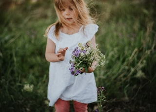 girl holding bouquet of flowers