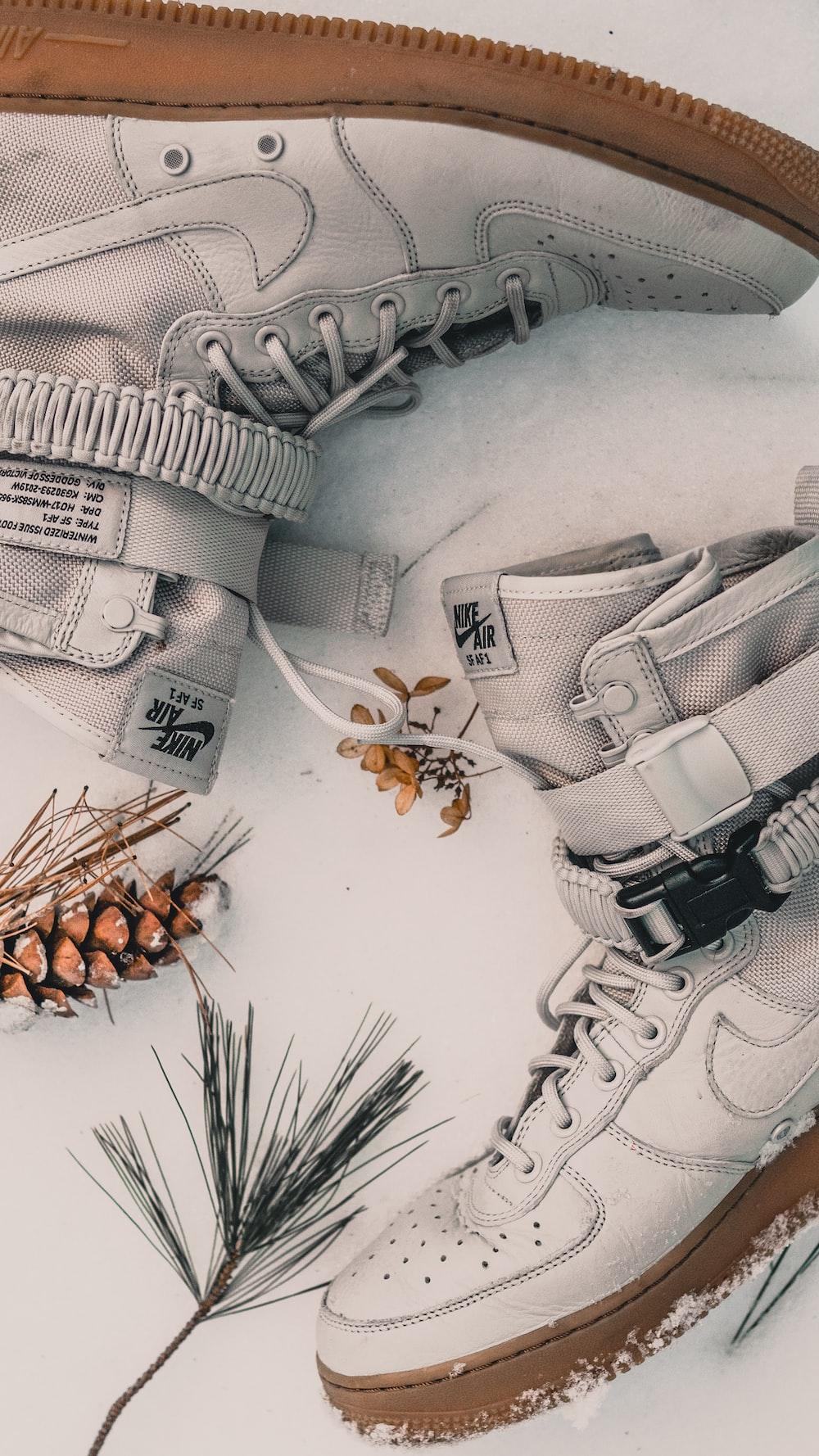 pair of white Nike Air high-top sneakers
