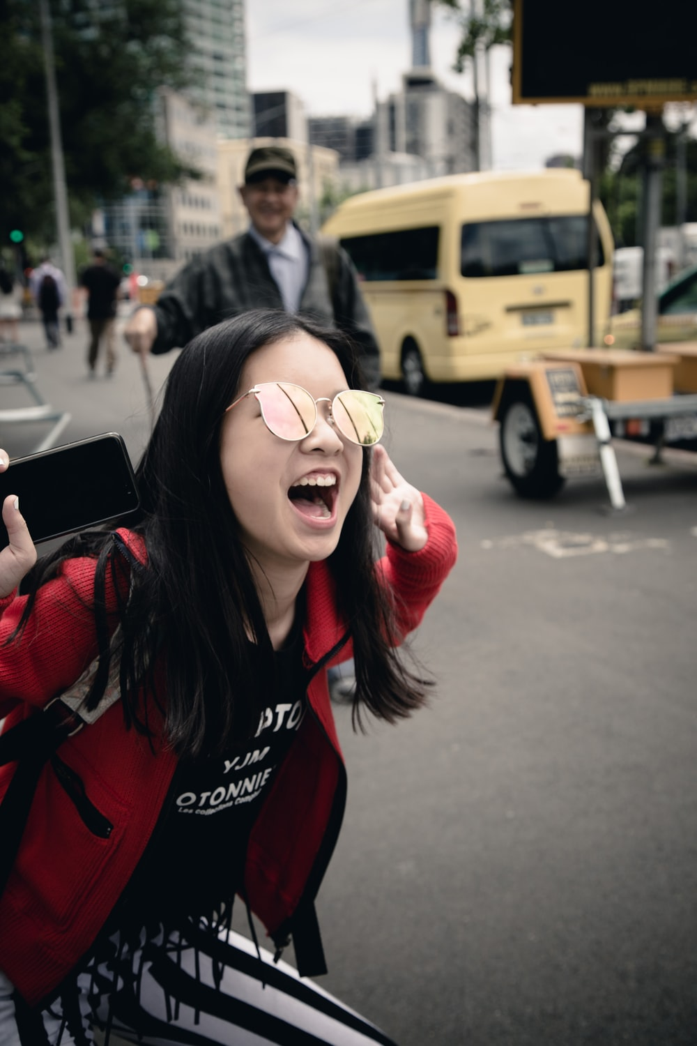 selective focus photography of woman shouting on road