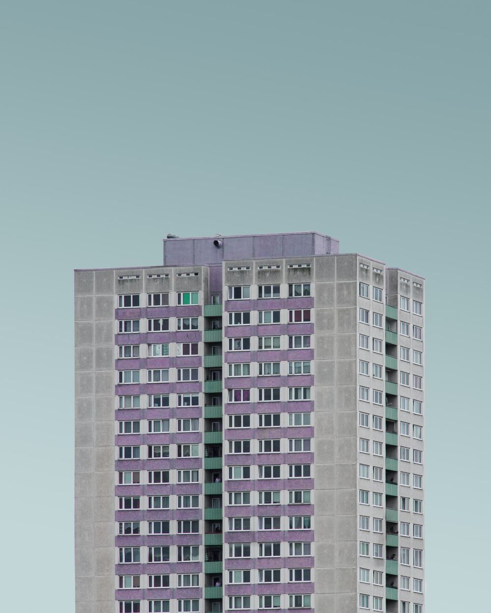 gray and purple high rise building under white clouds