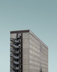 beige and brown concrete high-rise building