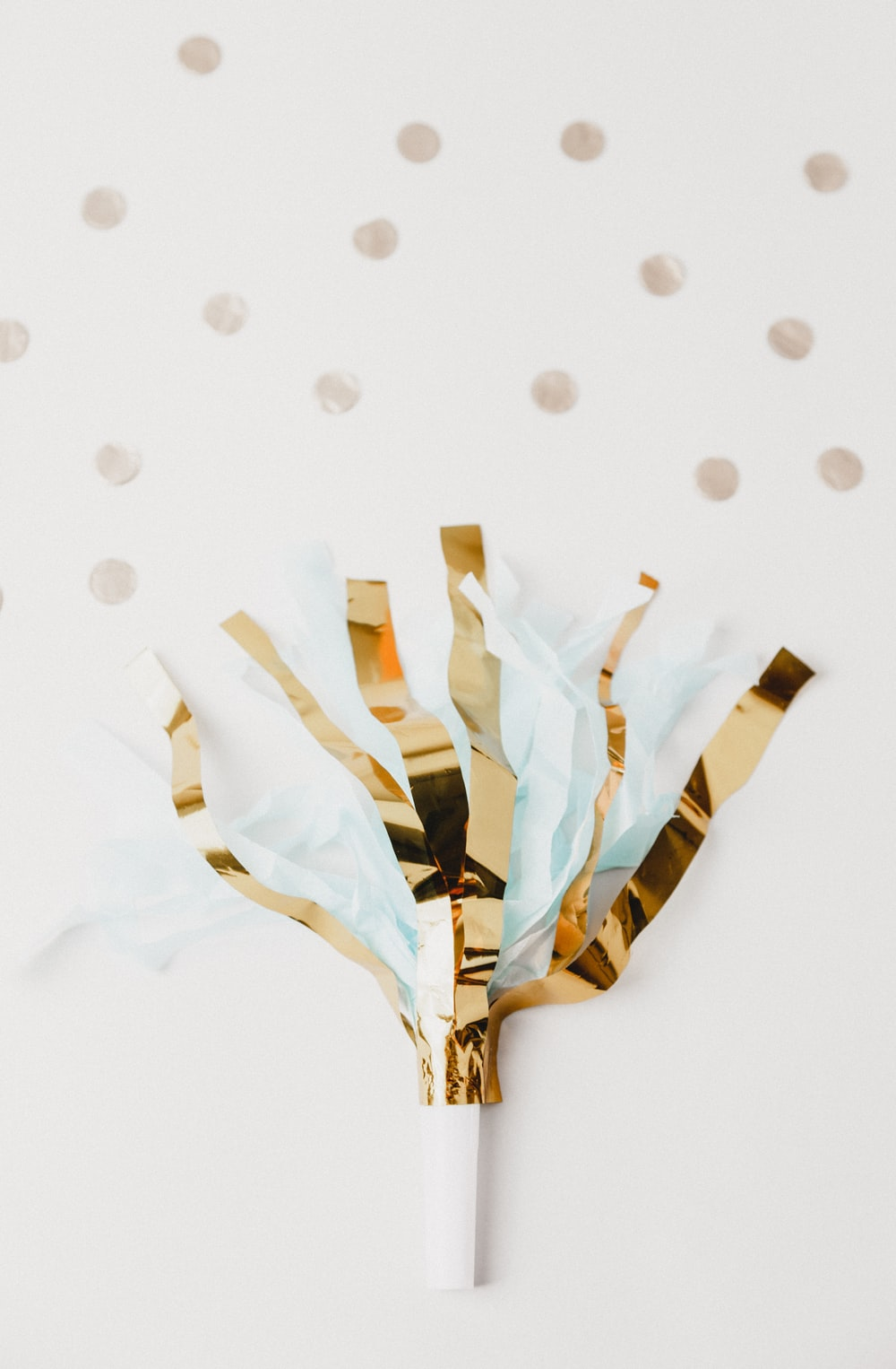 white and brown foil party decor on white panel
