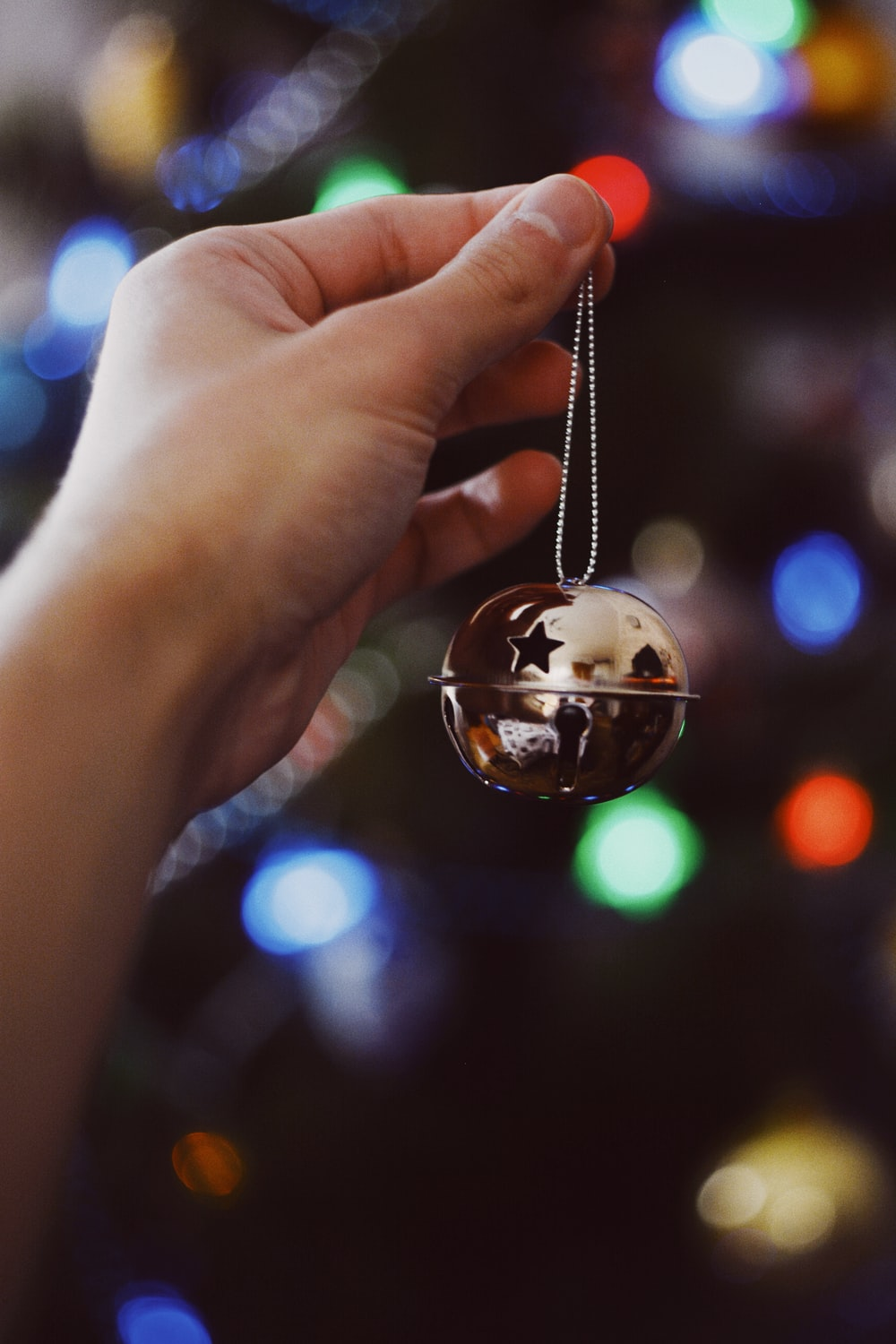 person holding Christmas ornament