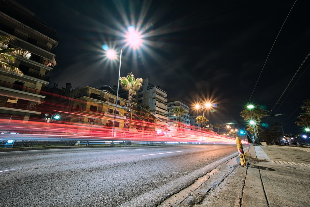 timelapse photography of road and highrise buildings