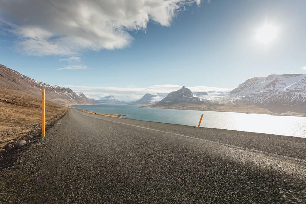 road beside body of water