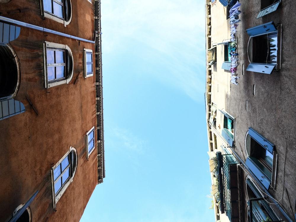 low-angle photography of two concrete establishments
