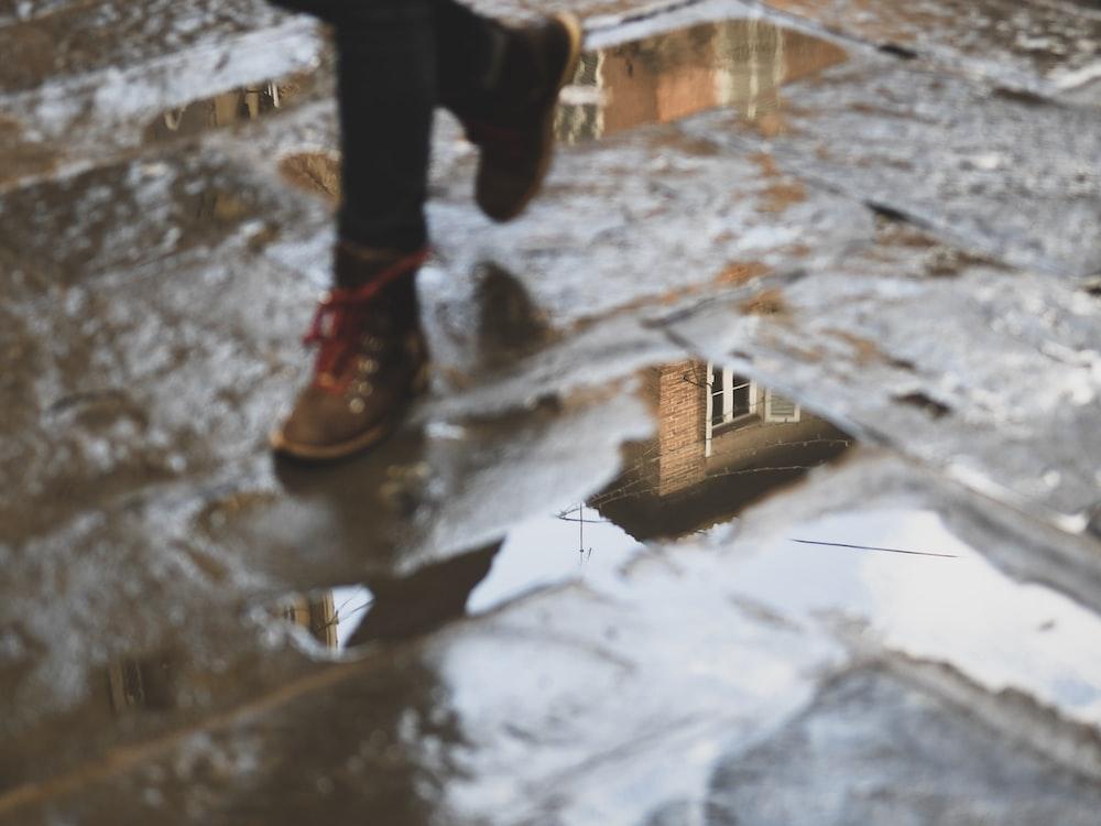 child walking on wet floor