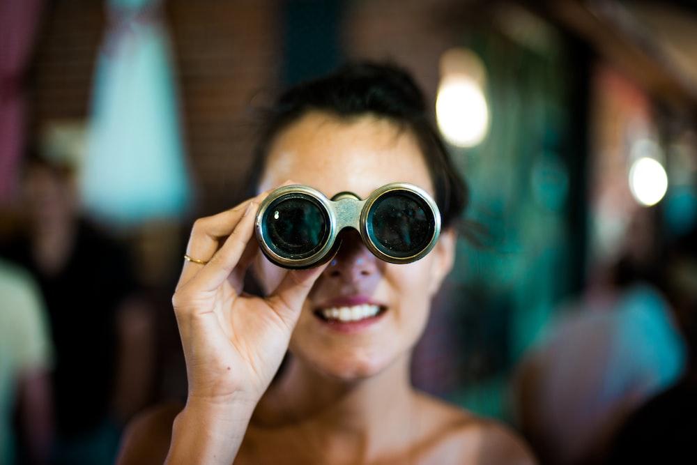 woman using gray binoculars