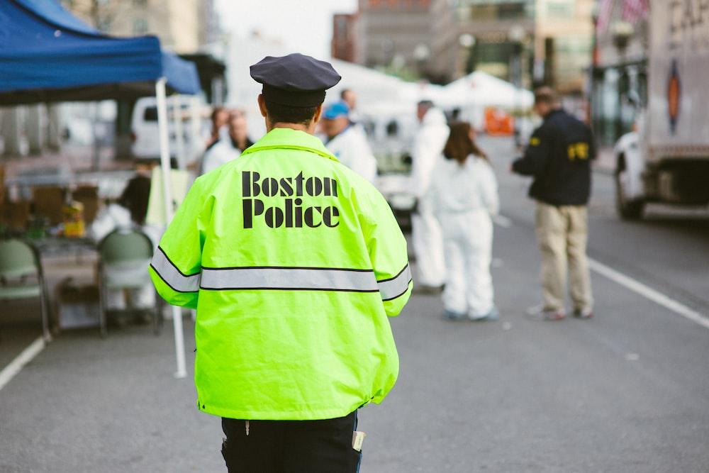 Boston Police officer walking on the street during daytime