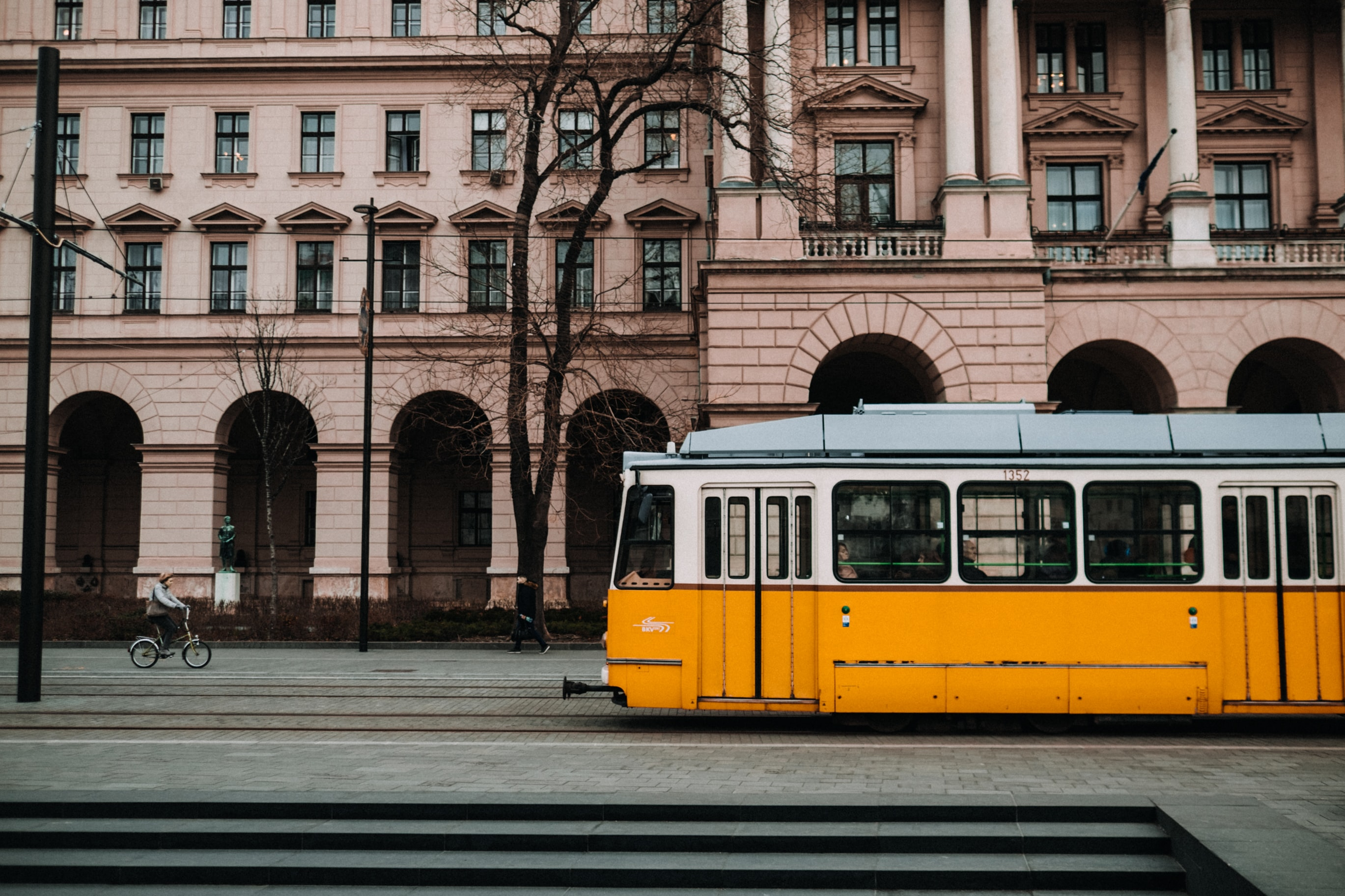 yellow and white train near building