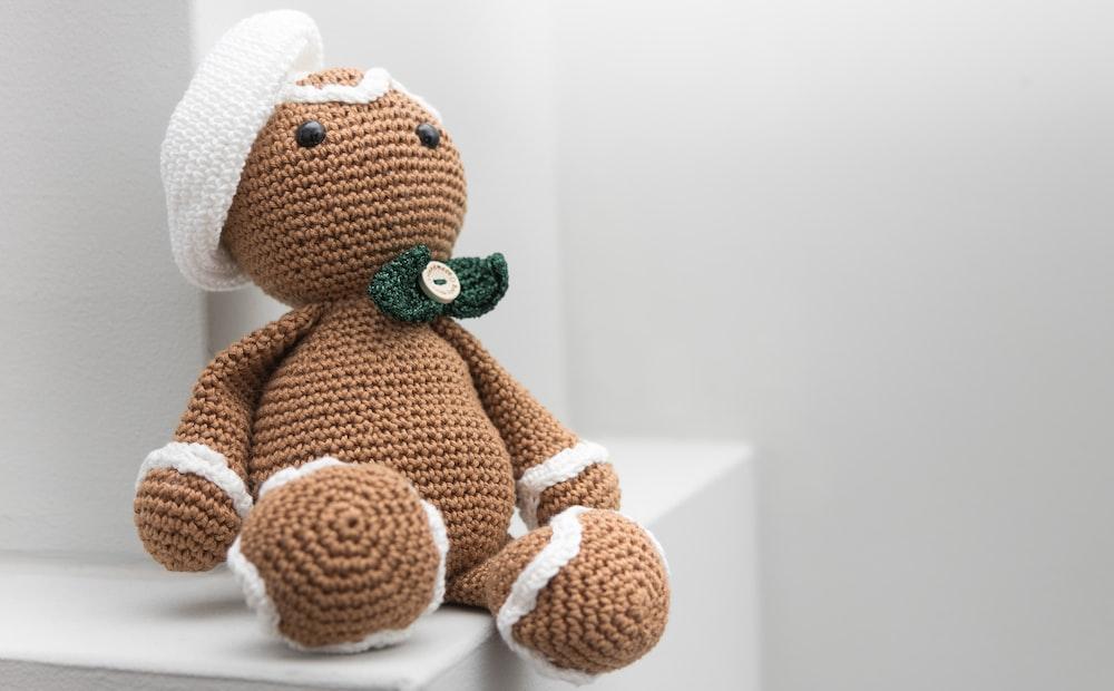 brown and white amigurumi doll