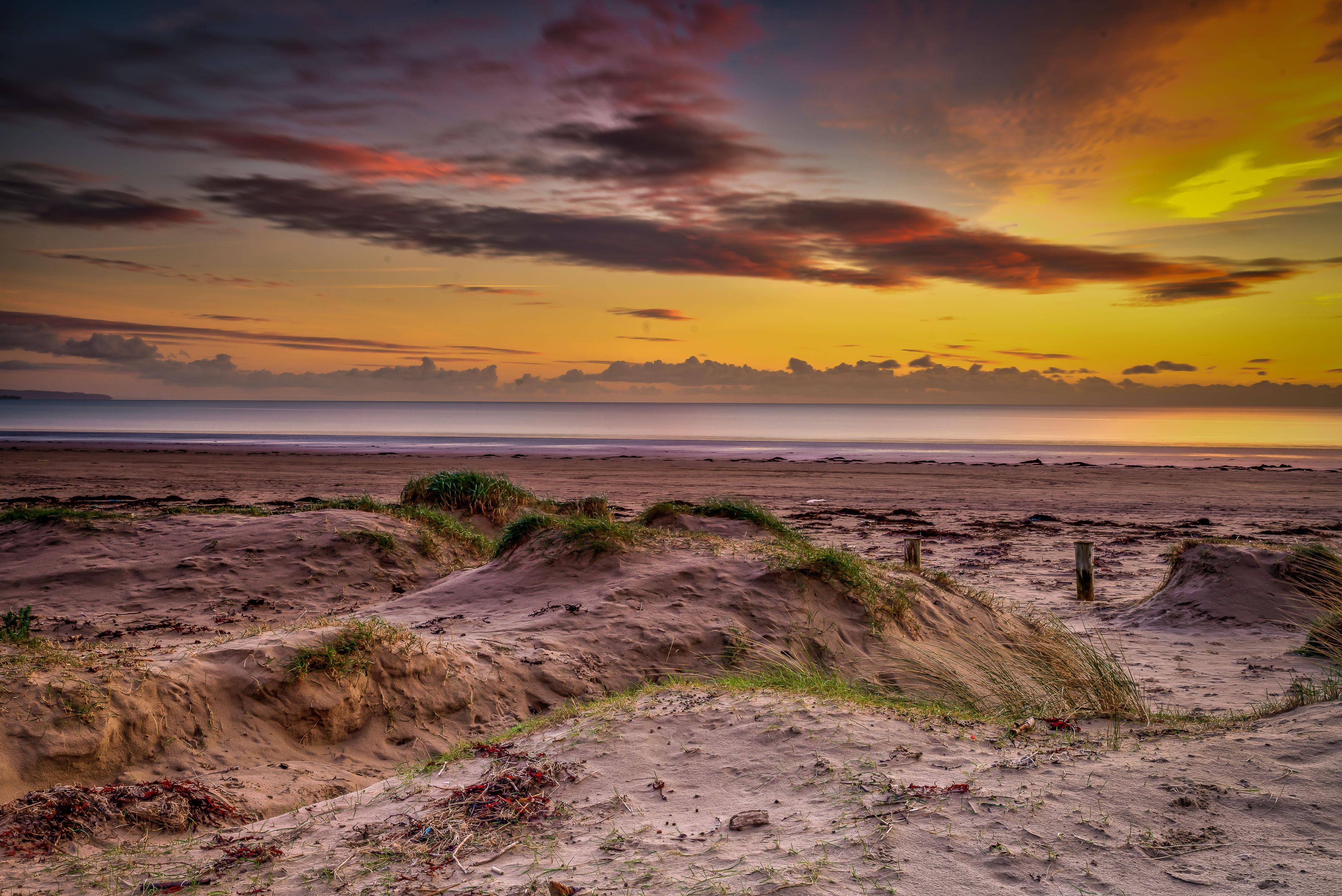 sand horizon under yellow sky