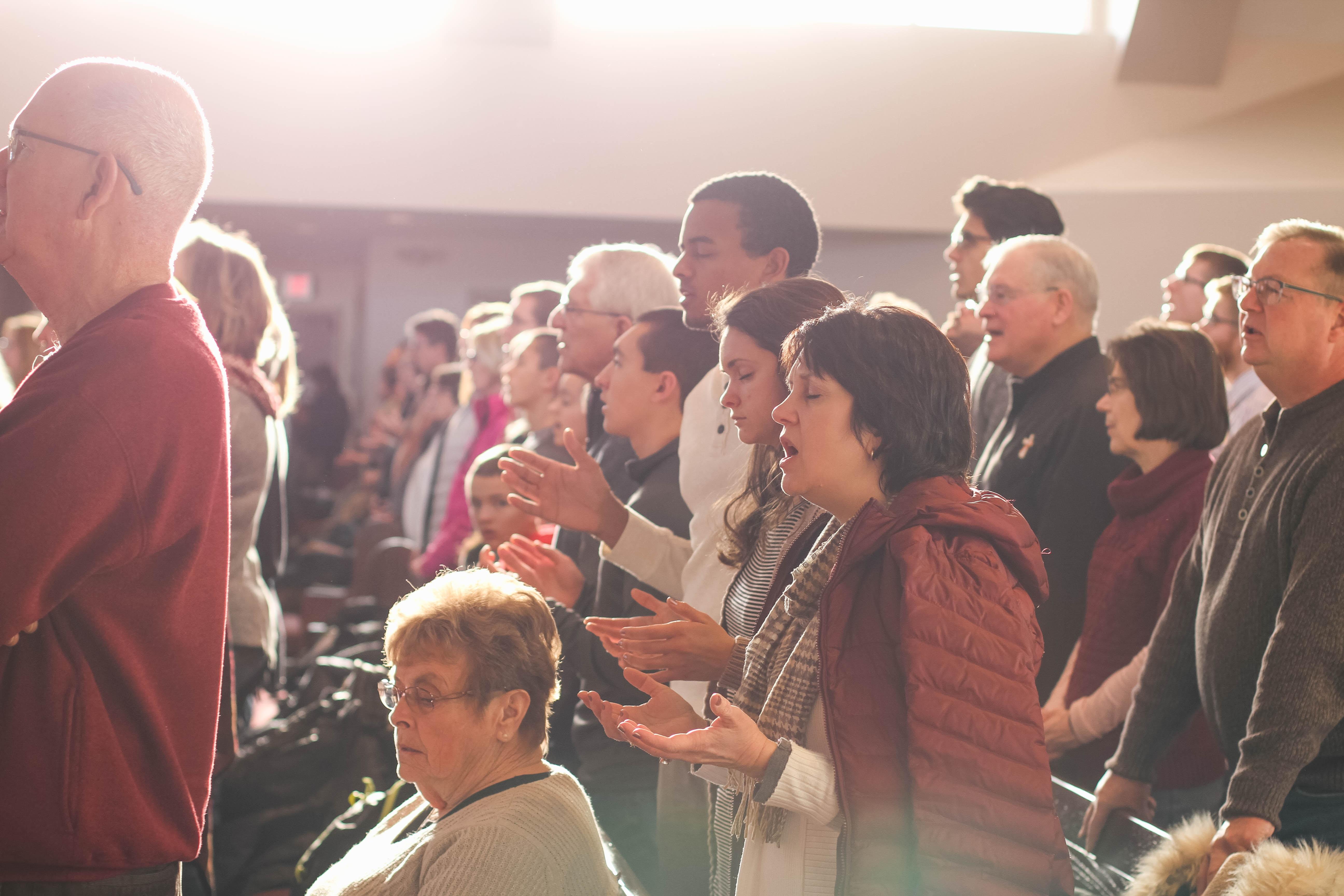 people worshiping god inside church