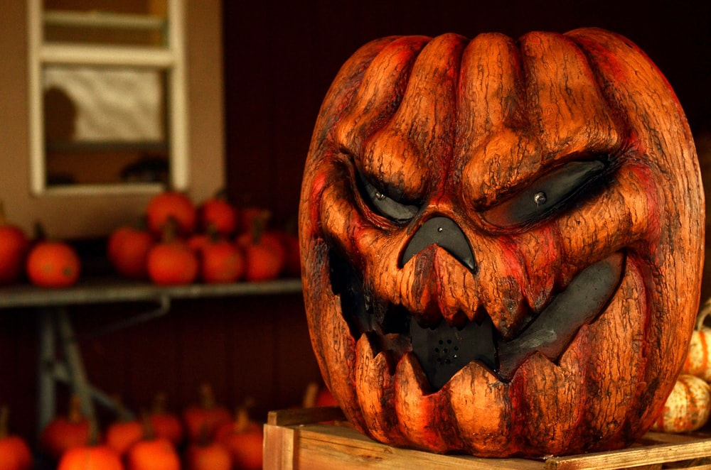 Jack-o-Lantern Halloween decor on top of brown table