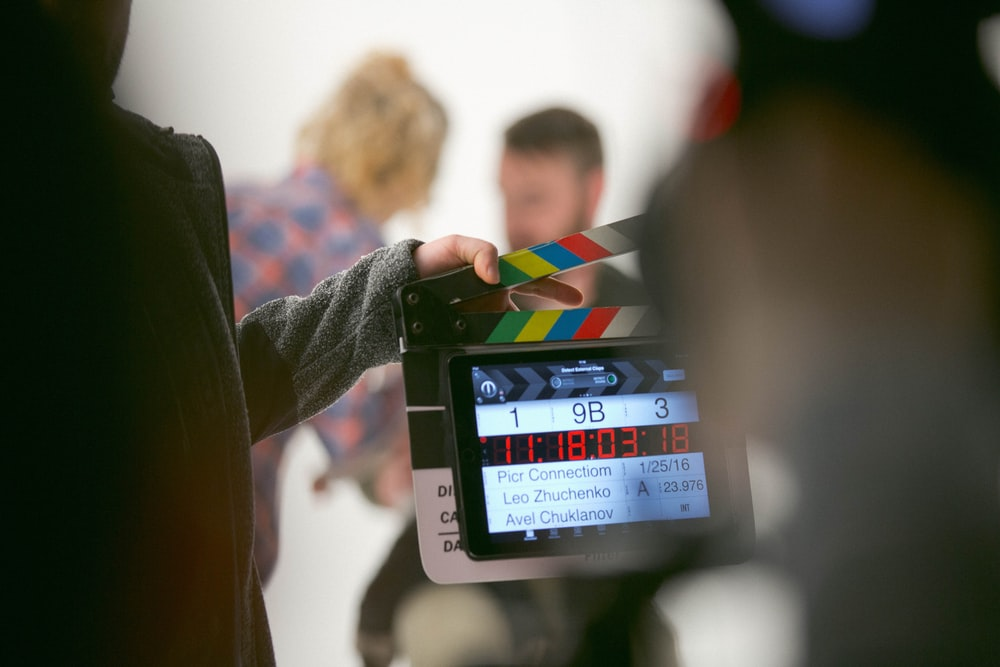 person holding clapperboard