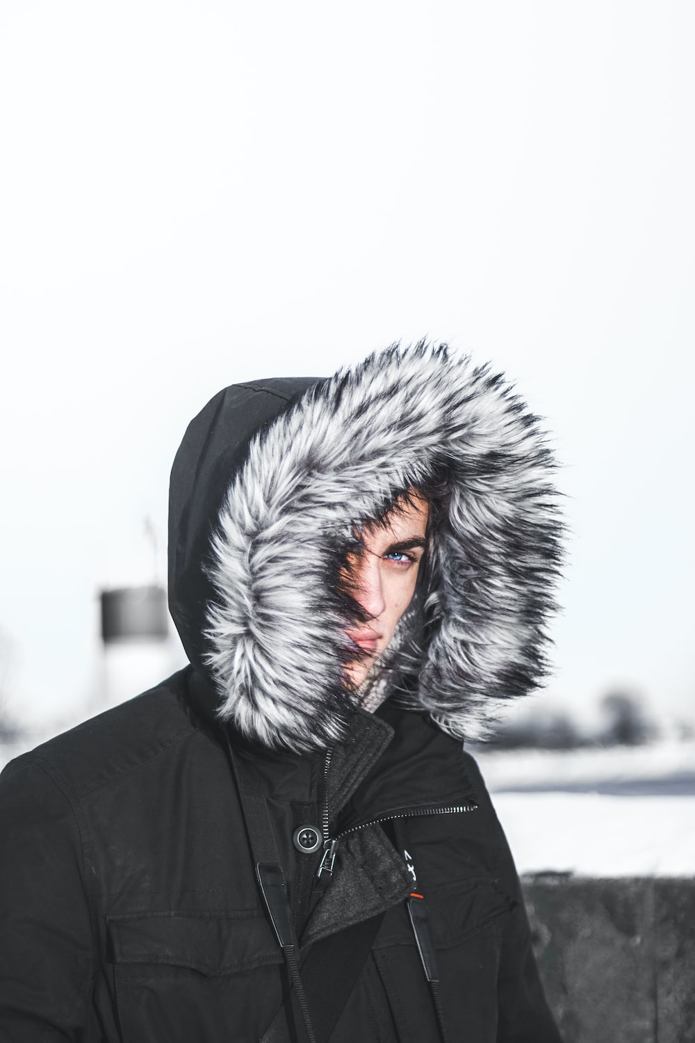 person covering face using hoodie