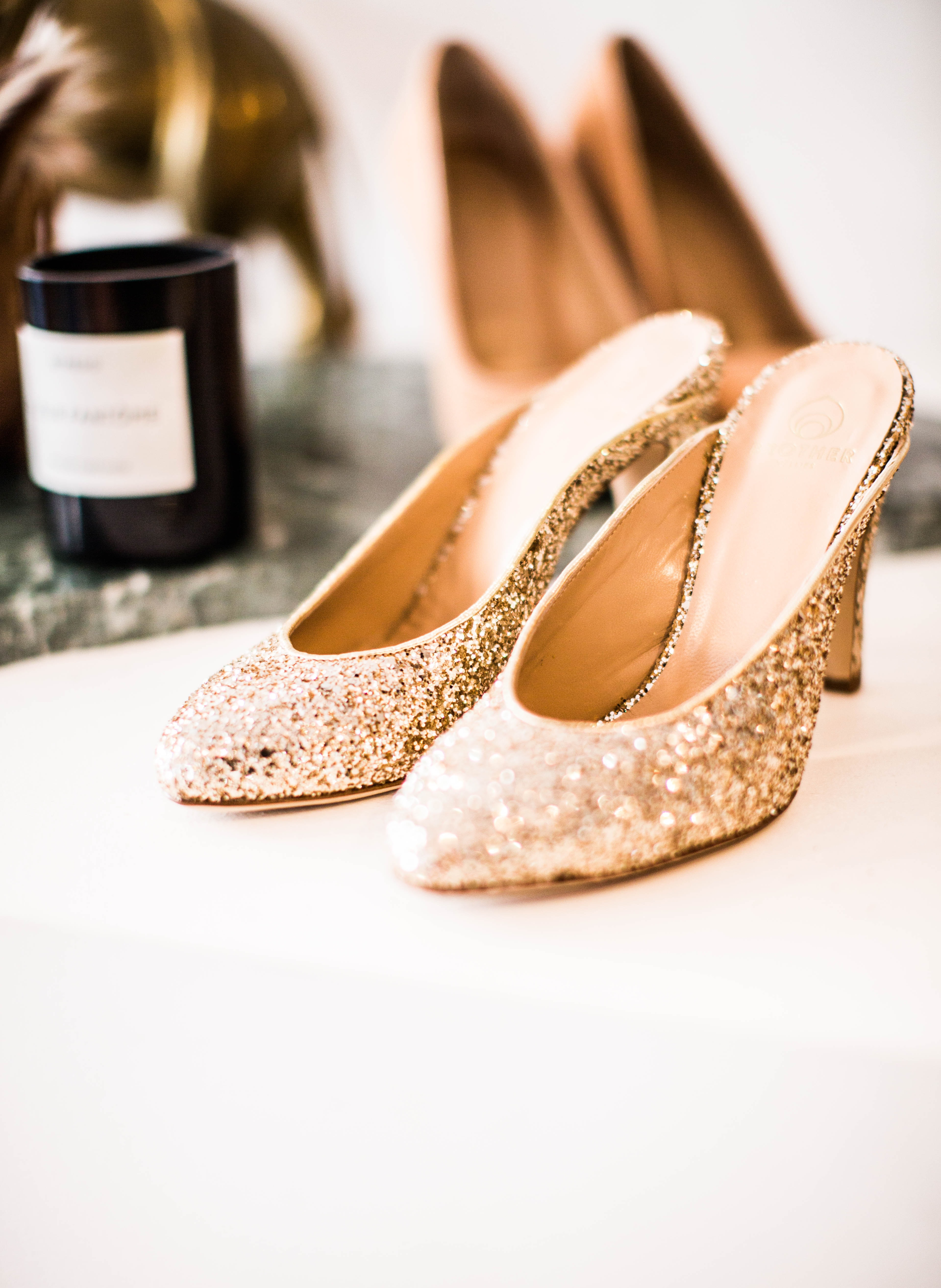 tilt-shift lens photography of glittered gold sandals