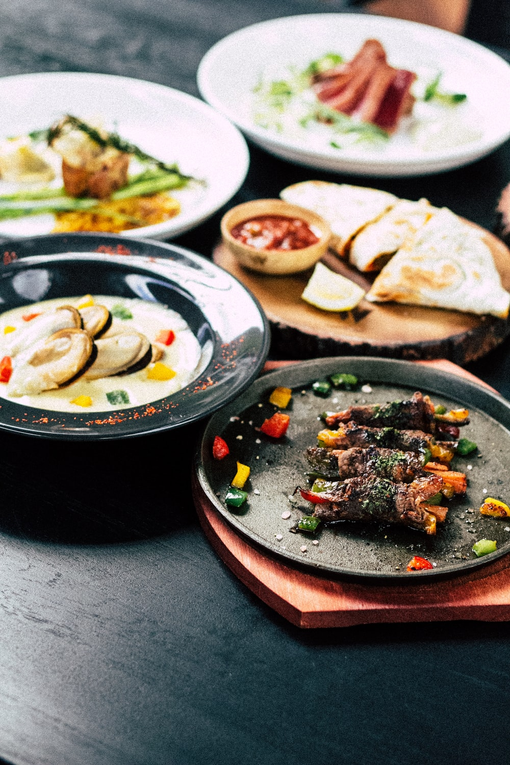 cooked food on top of black and white ceramic plates