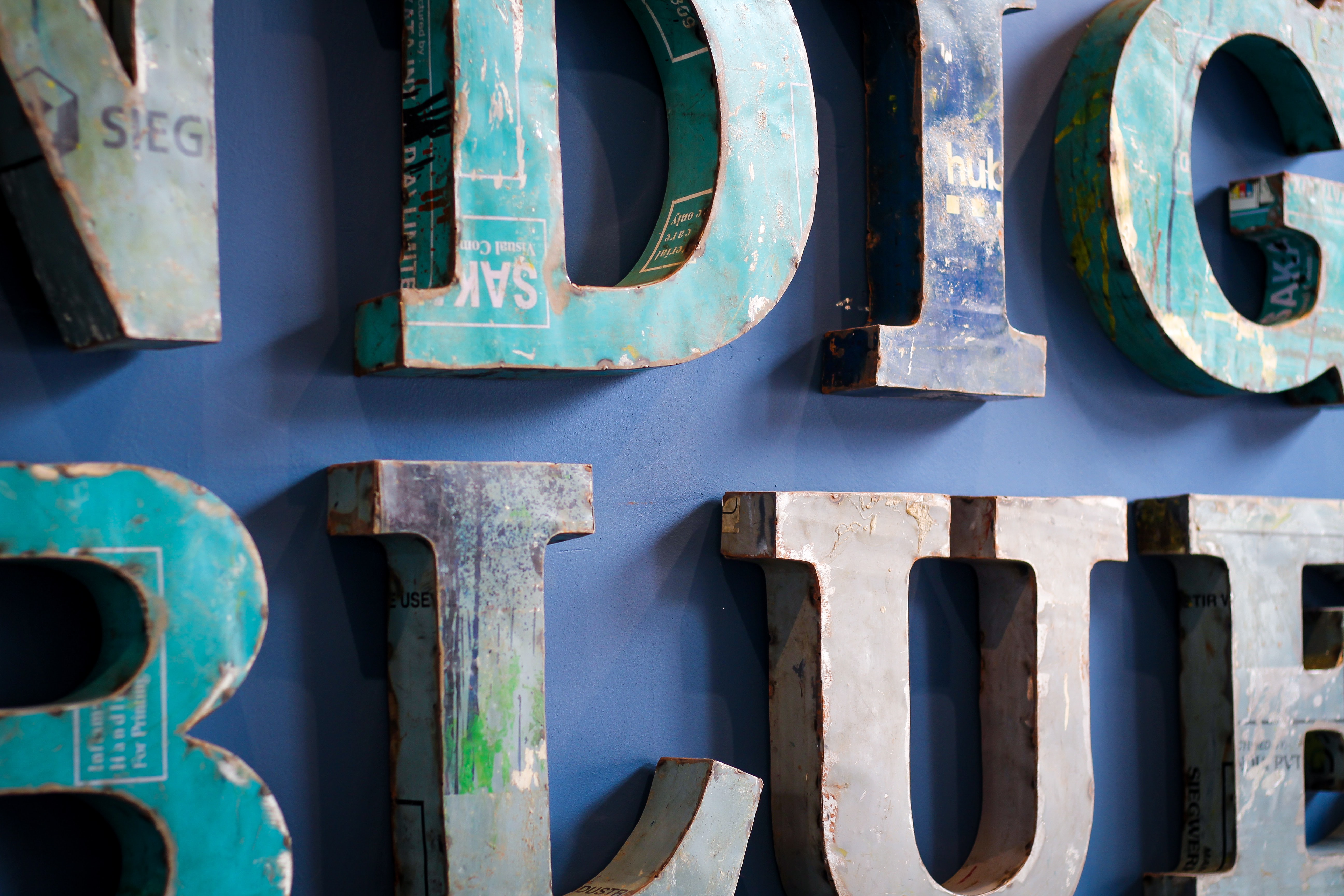 blue and grey wooden letter wall decor