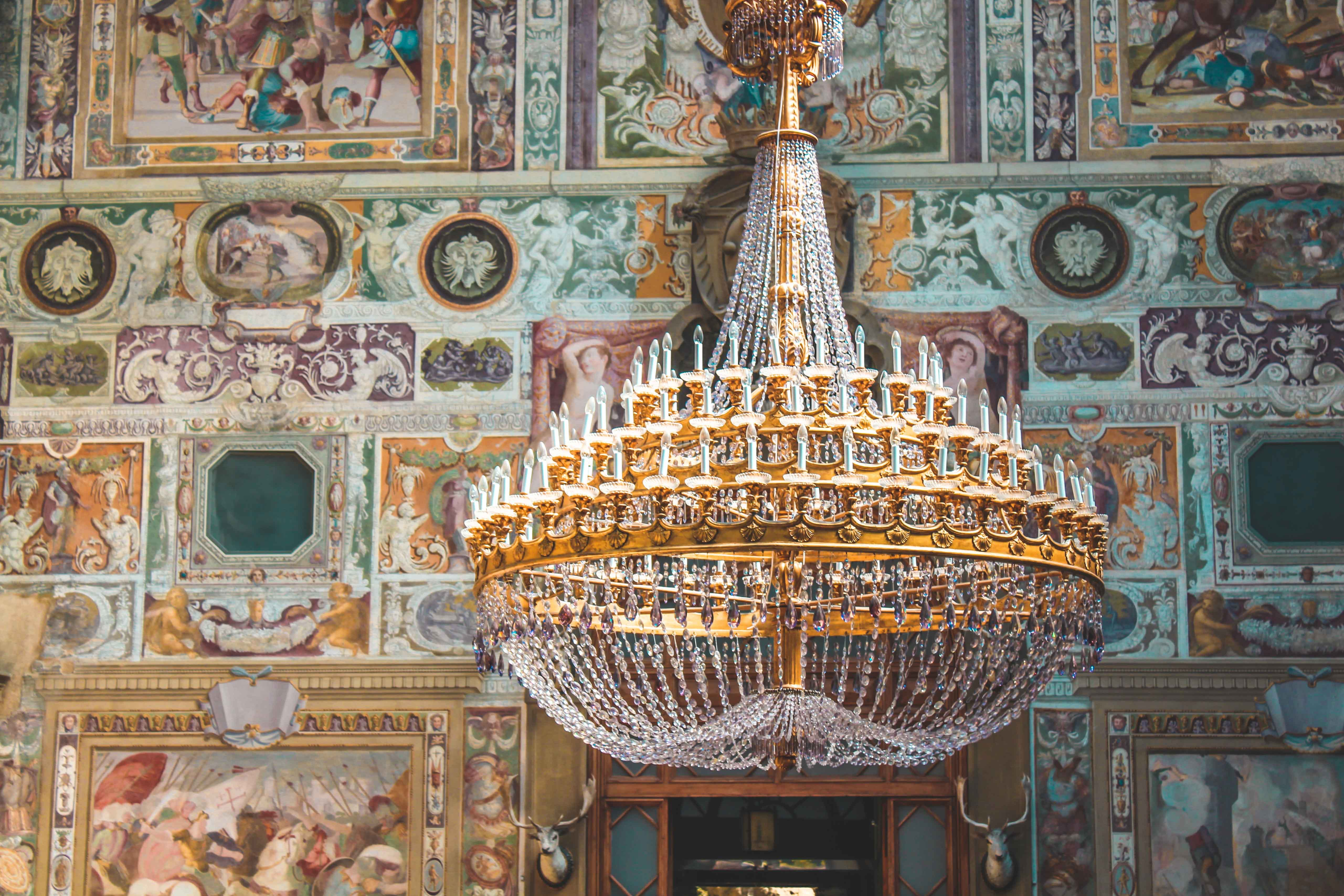 turned off brass-colored chandelier