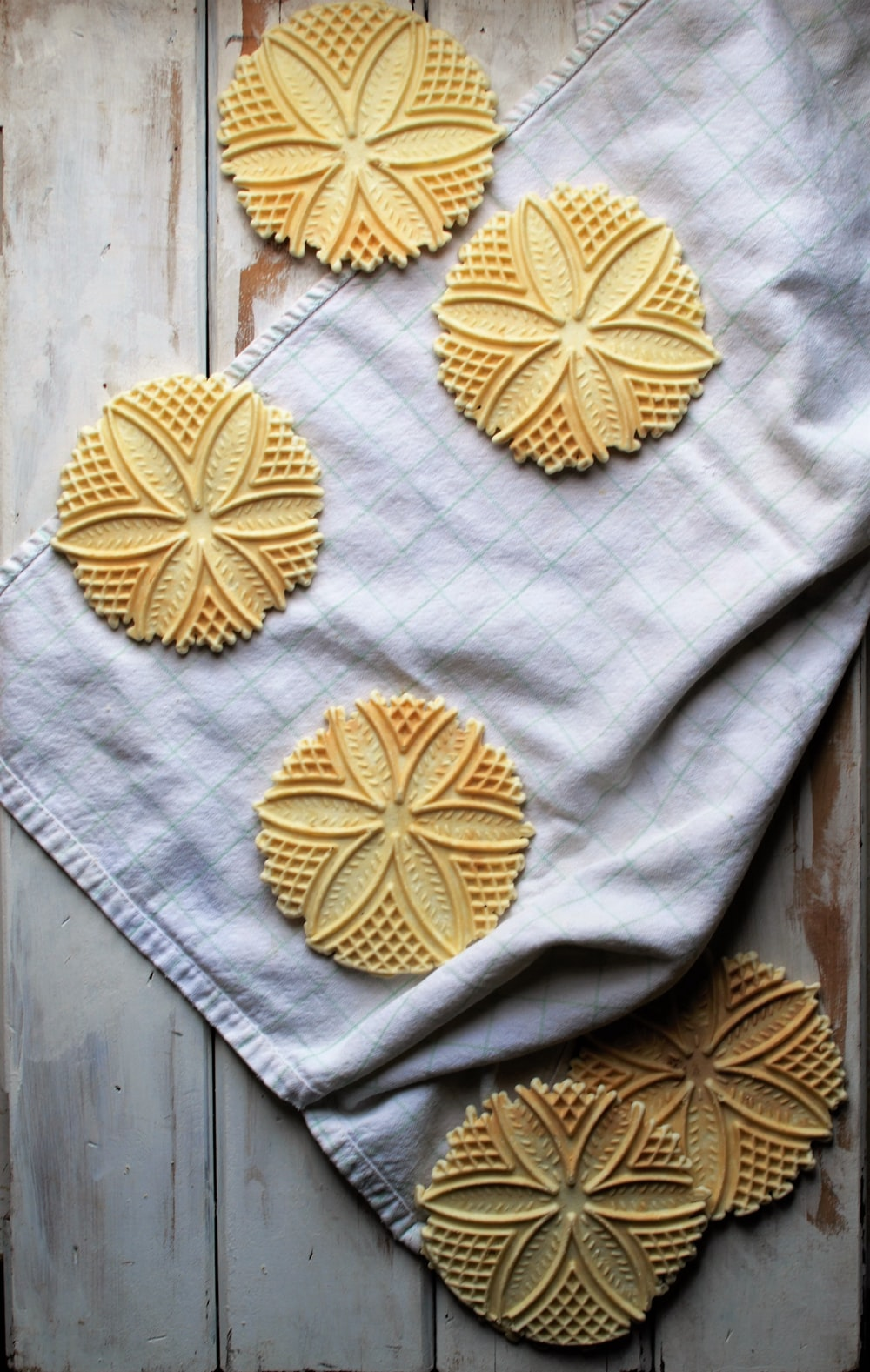 round brown pastries on top of white textile