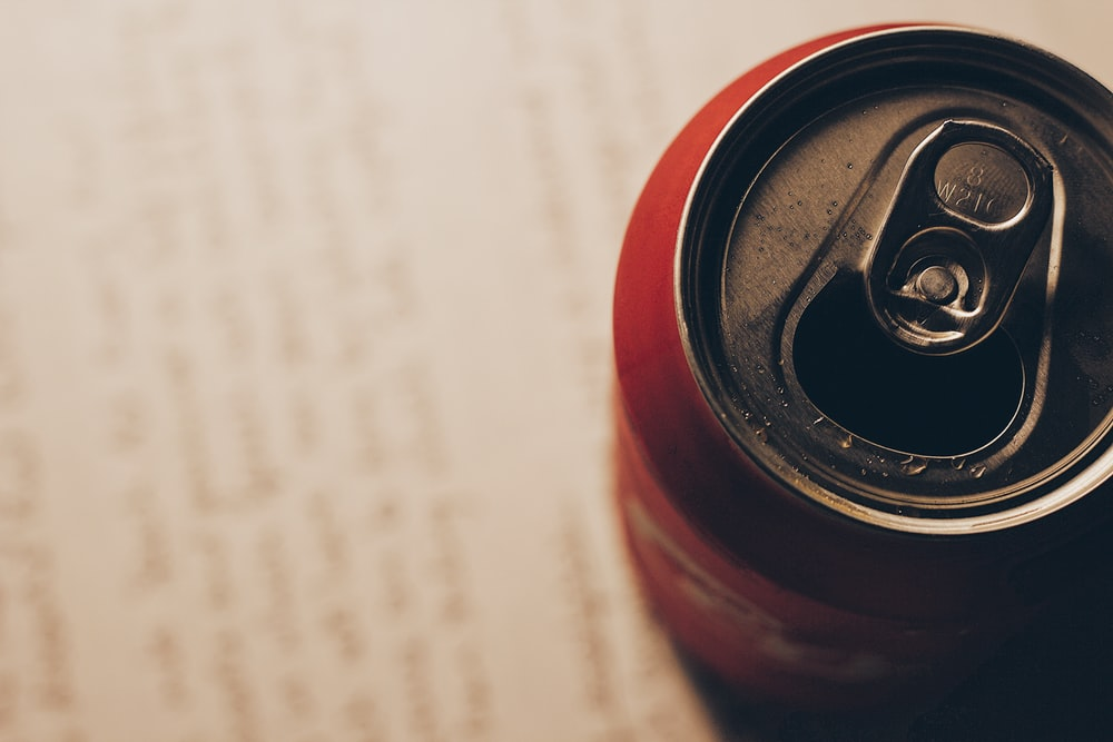 red can on paper