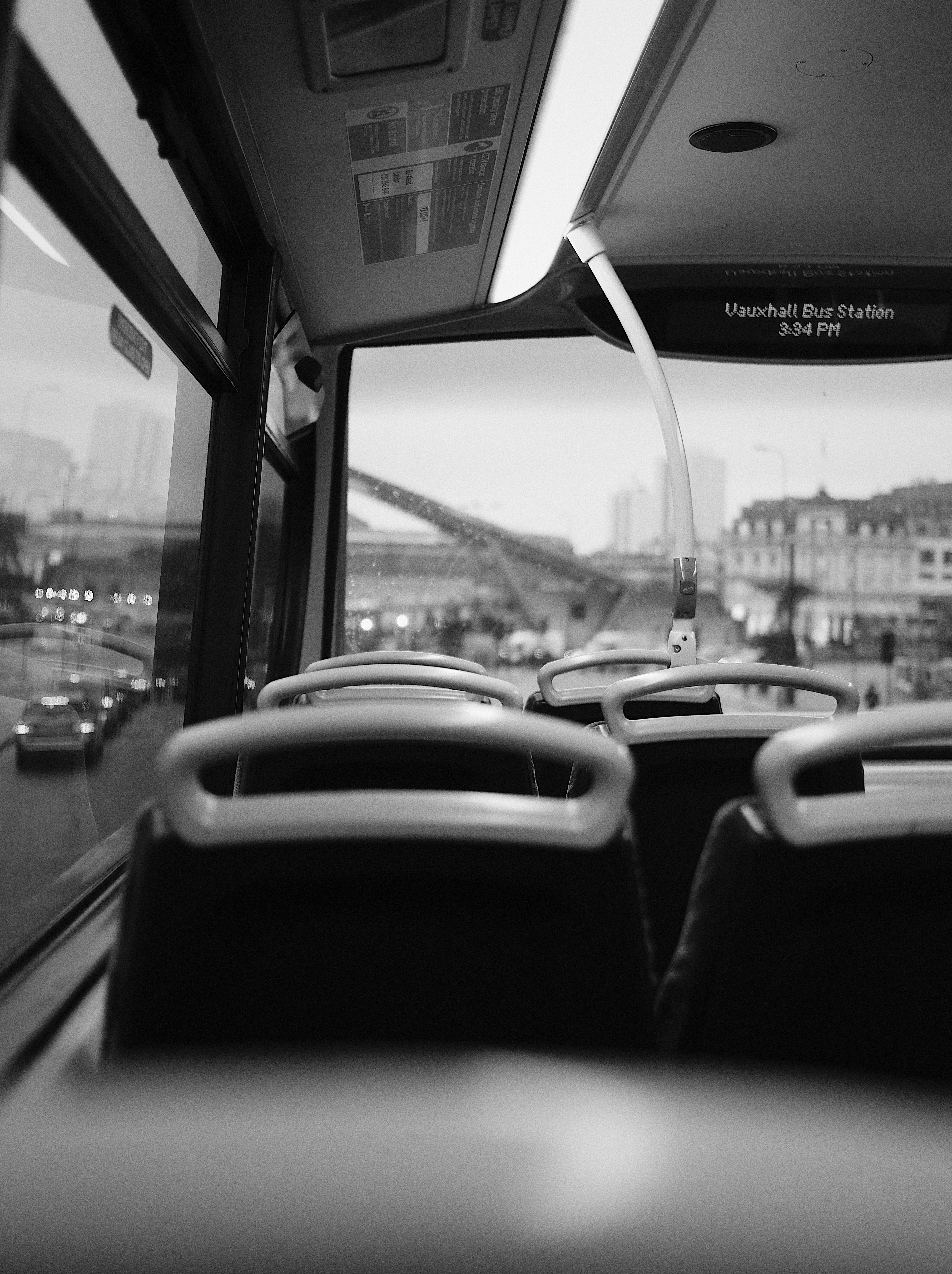 grayscale photo of bus interior