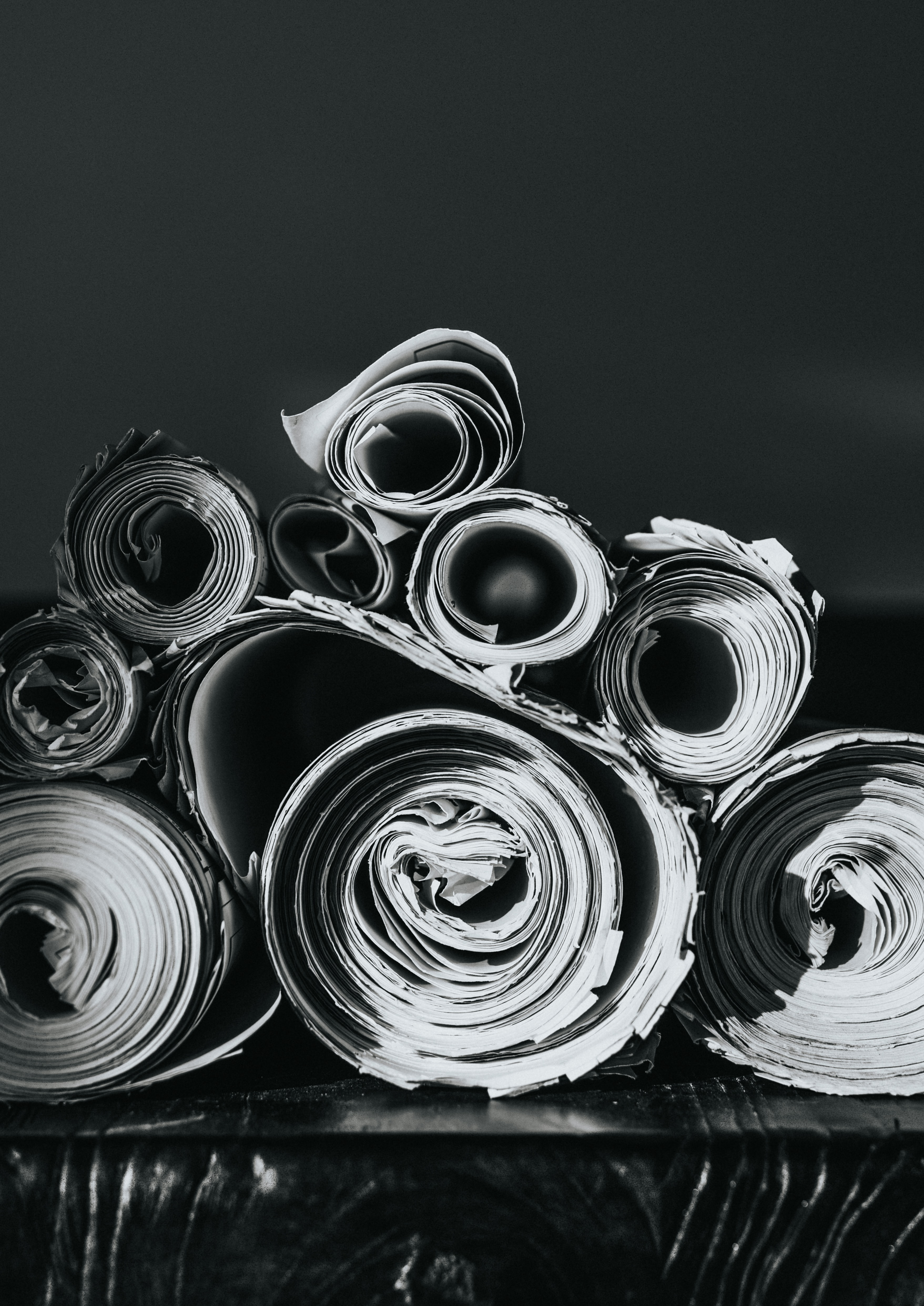 grayscale photo of rolled papers
