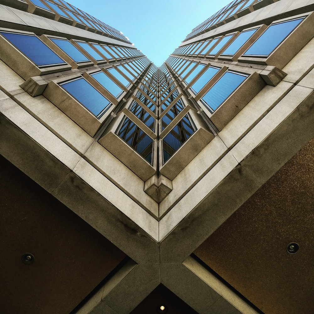 low angle view photography of brown high rise building