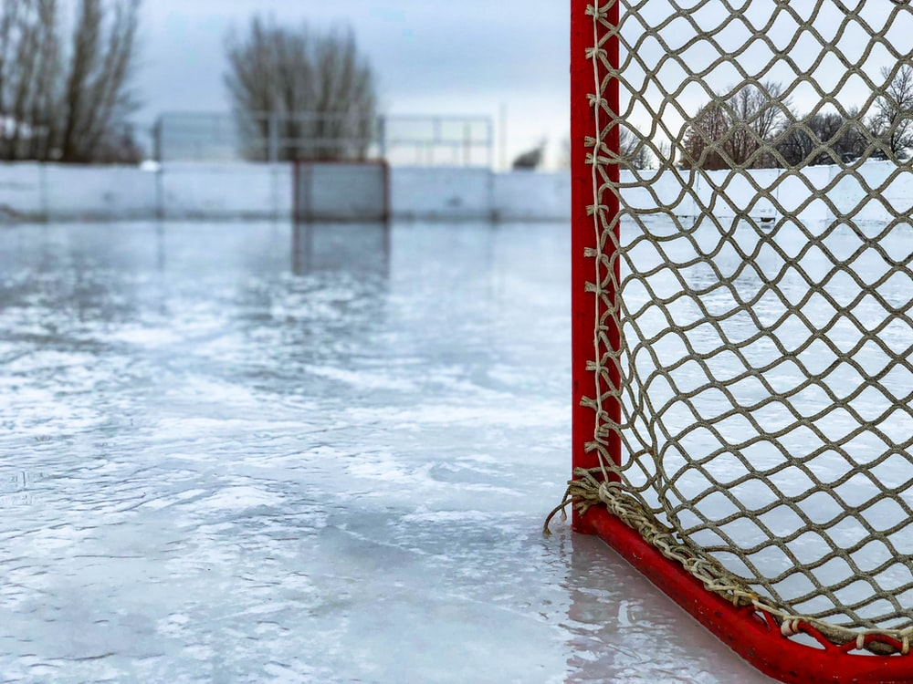 red and white hockey goal