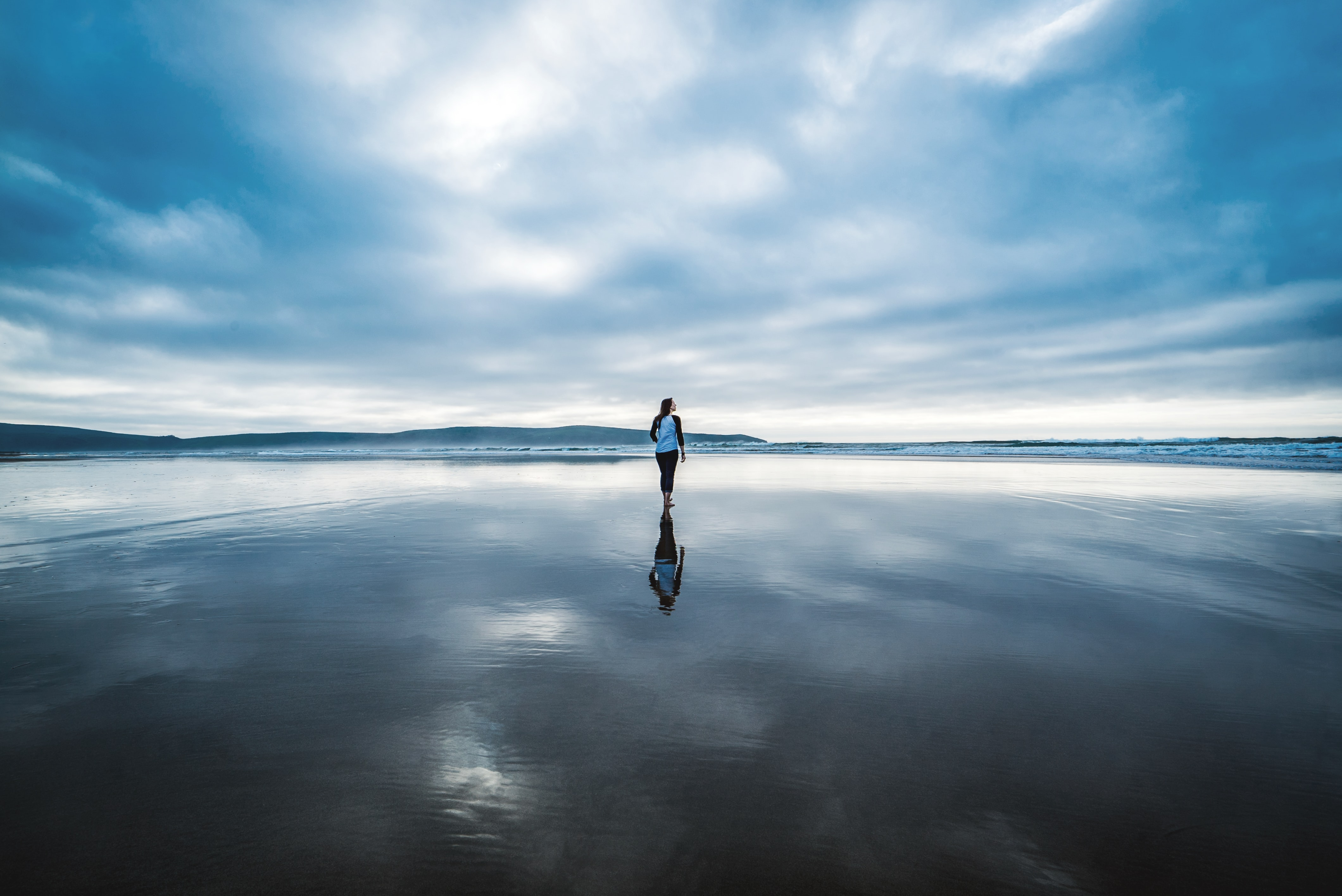 photography of person on body of water during daytime
