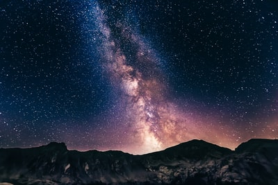 milky way on mountains stars zoom background