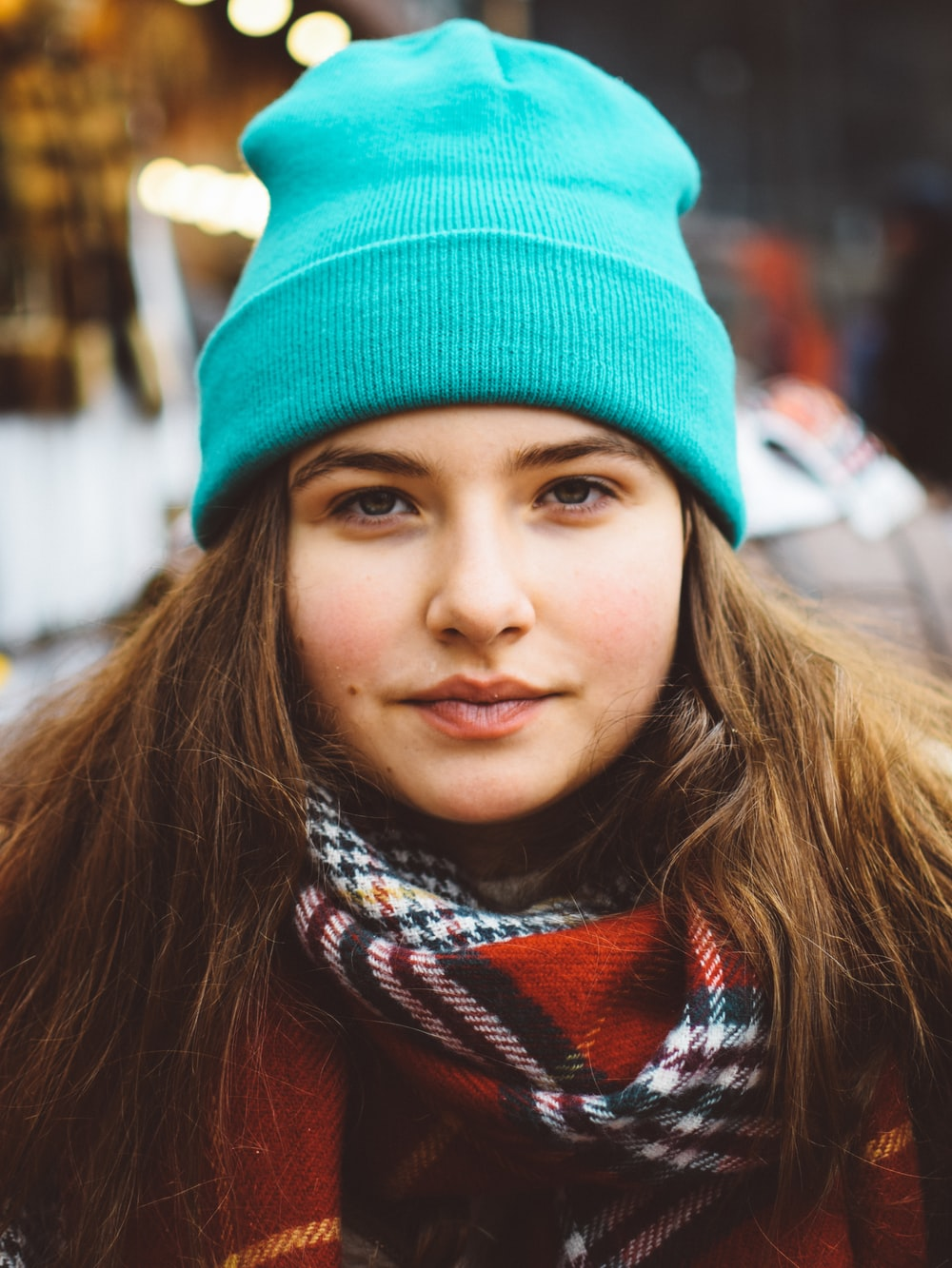 woman wearing scarf and knit cap