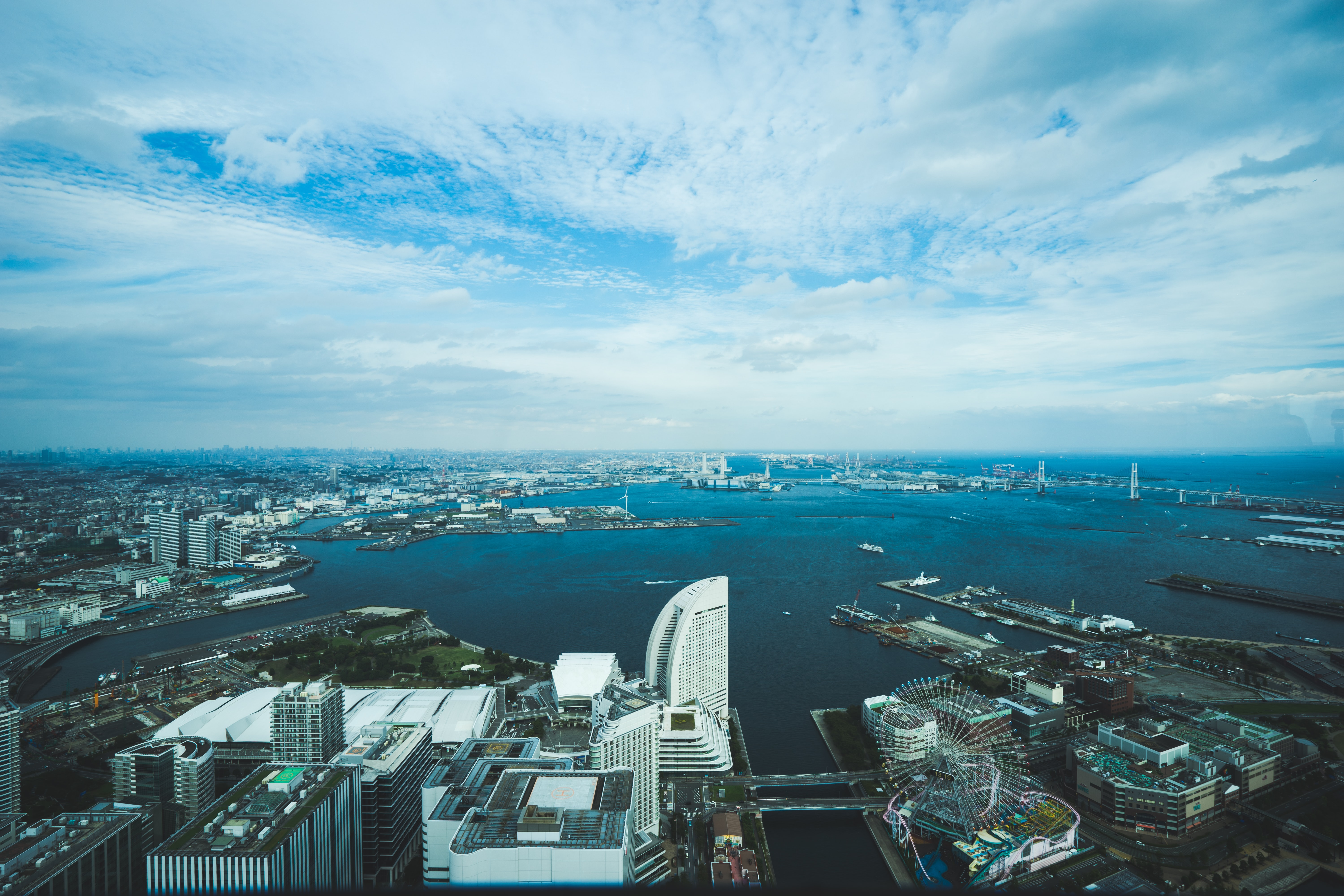 bird's eye view of city beside wide body of water during daytime