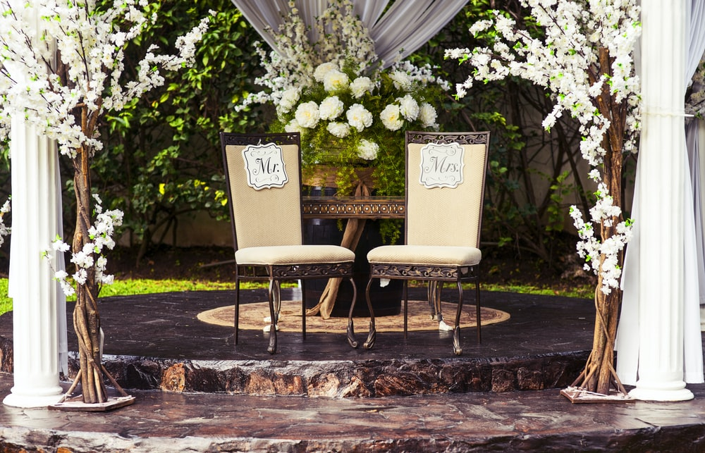 two black steel chairs beside table