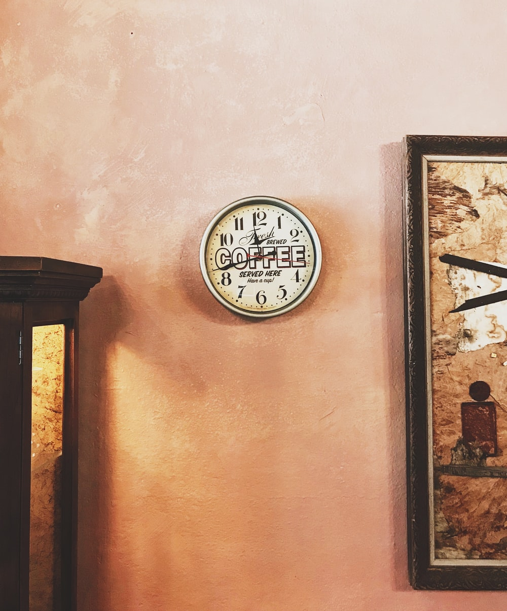 round wall clock showing time at 11:43