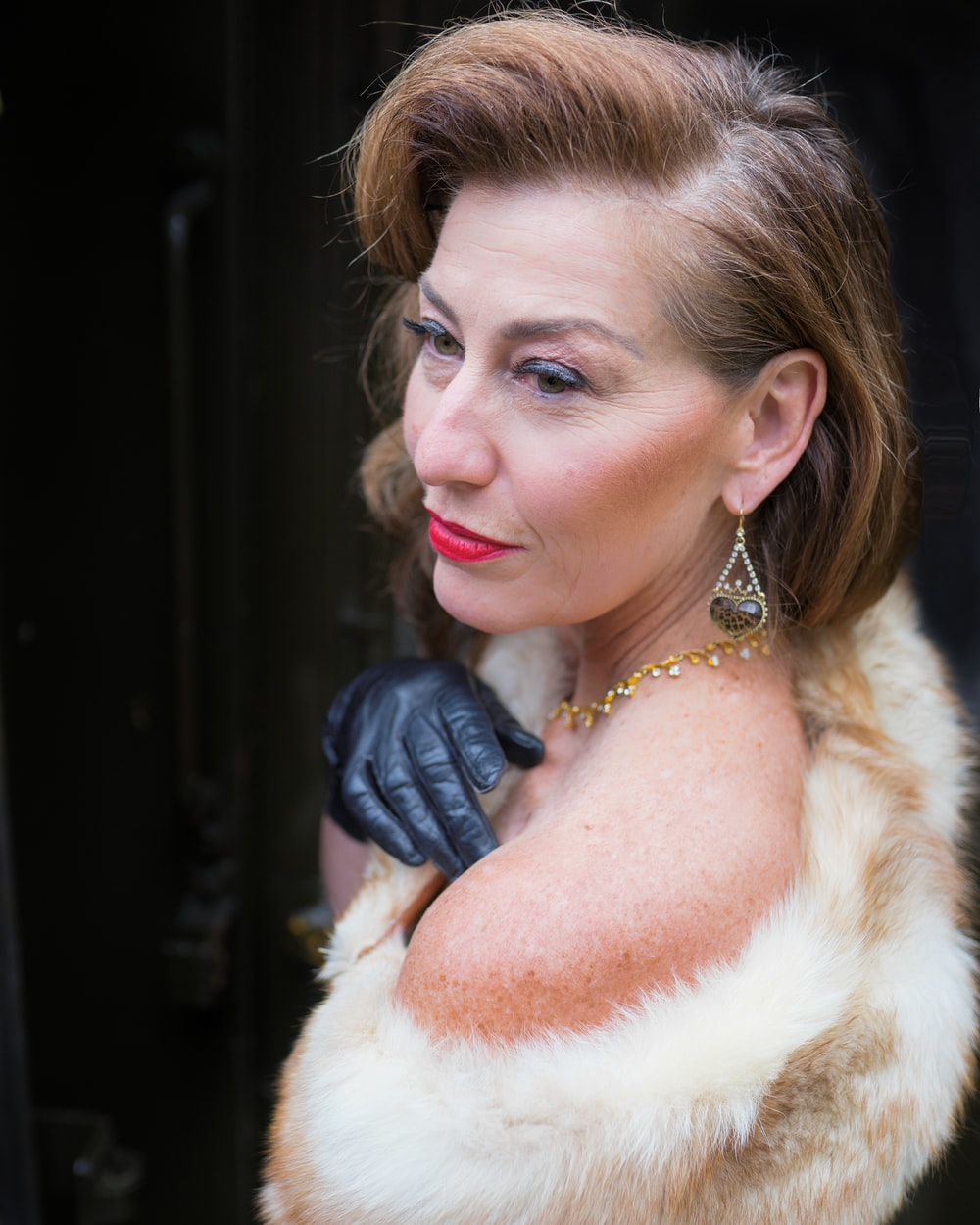 woman wearing white and tan fur top