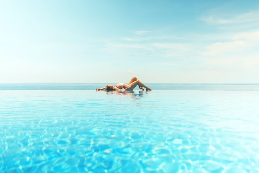 woman sun bathing on beach