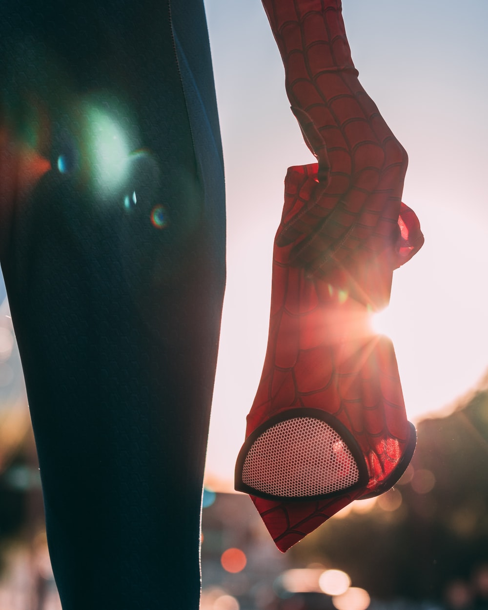 person holding Spider-Man mask