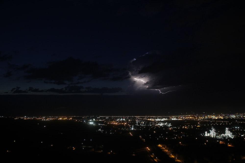 photo of lightning above city
