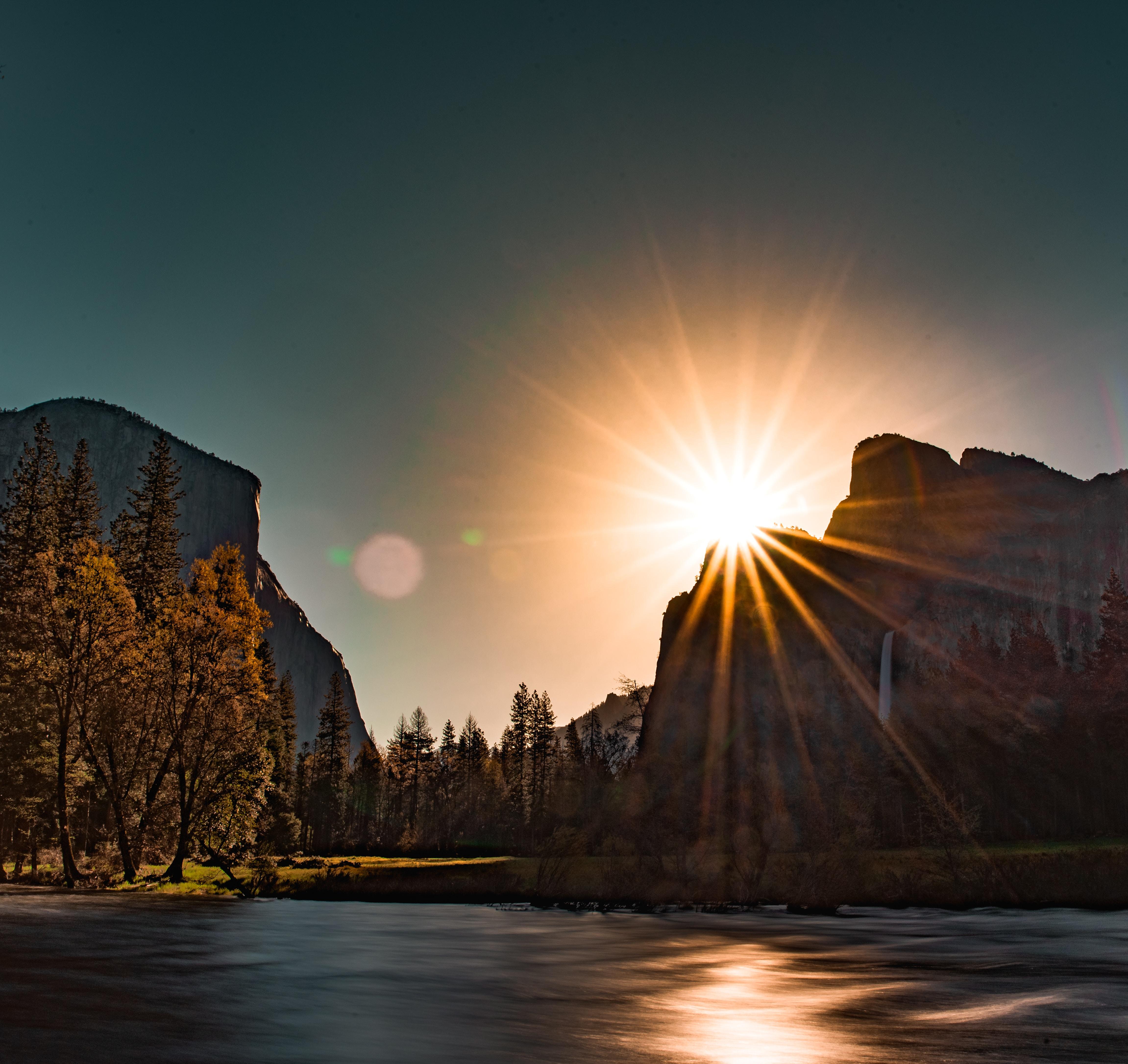 sunrise over mountains near river
