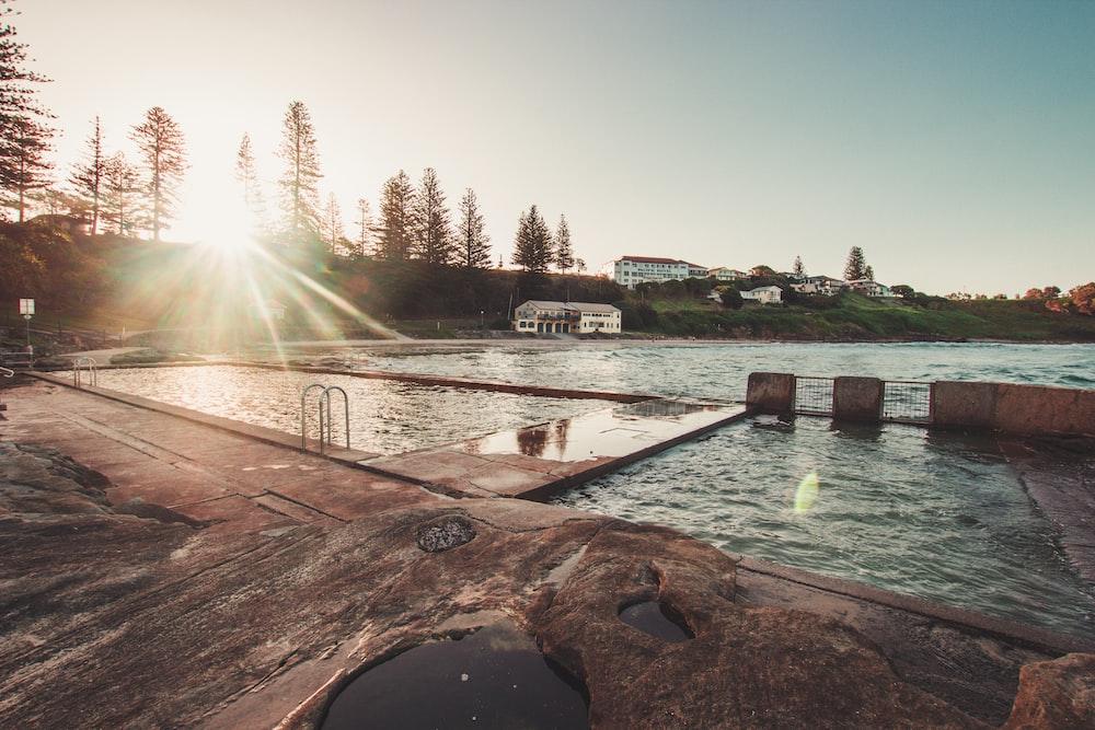 Swimming pool at sunset photo free yamba image on unsplash for Pool builders yamba
