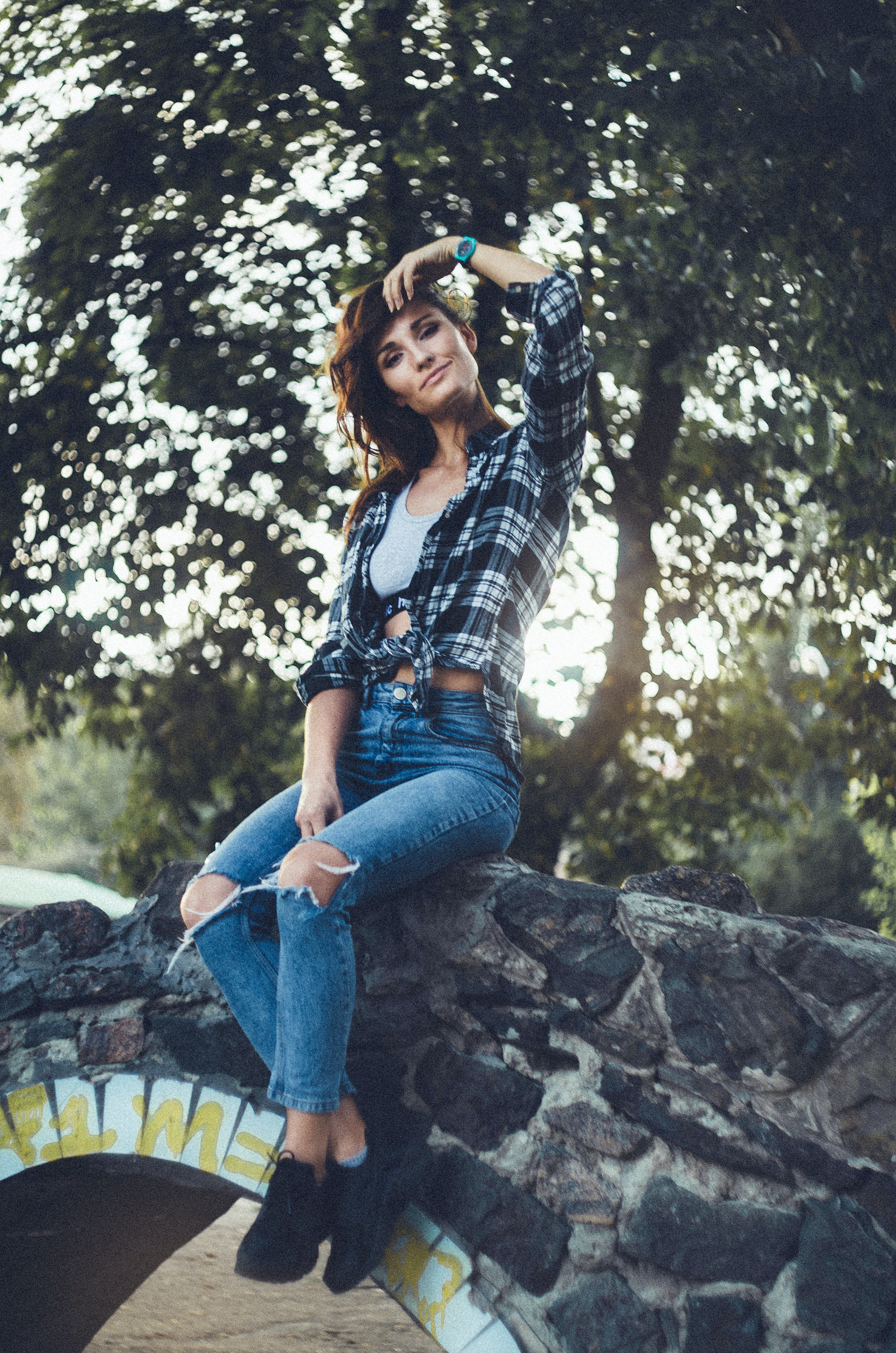 woman sitting on bridge posing