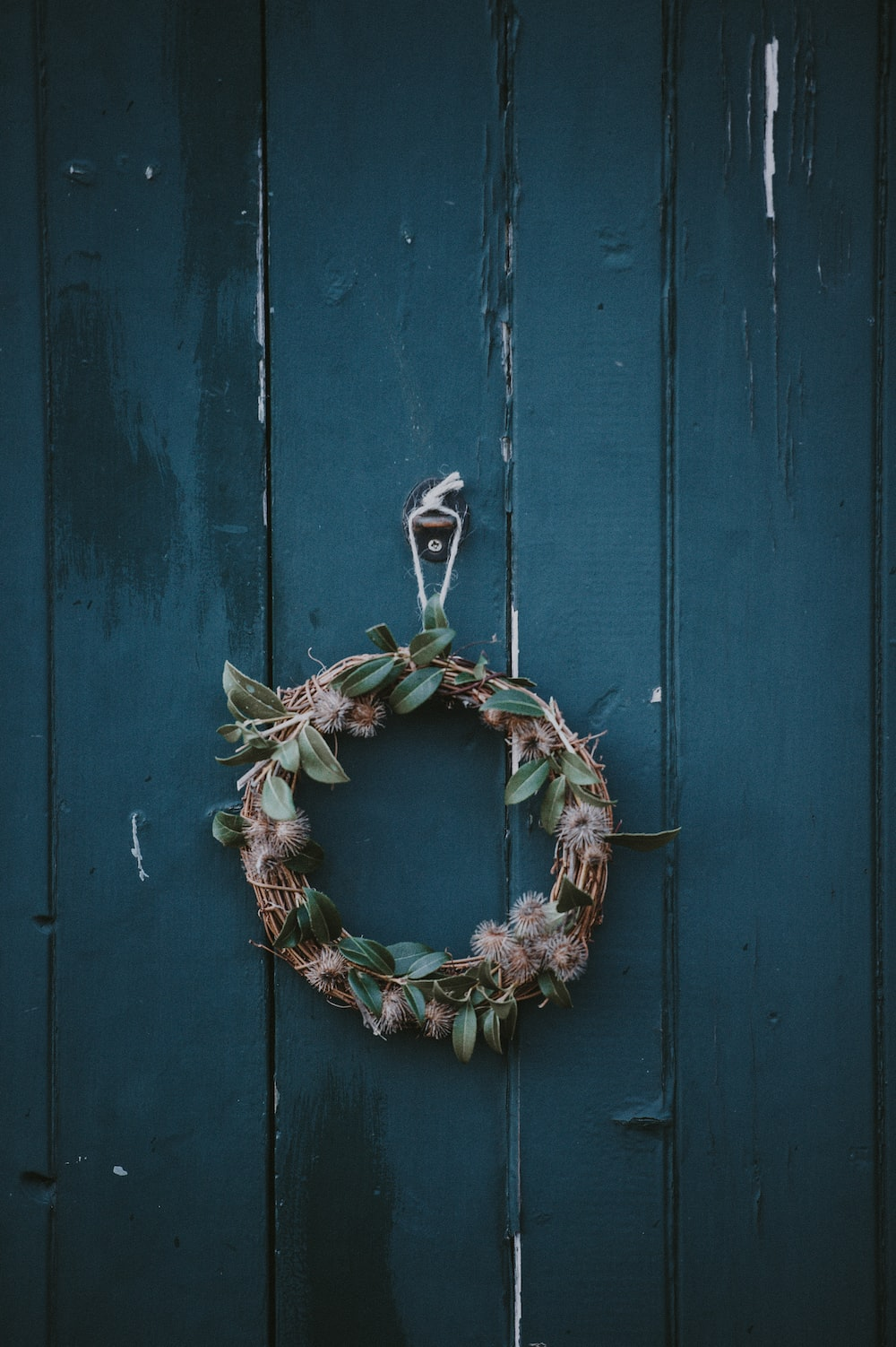 brown and green wreath hanging on wall
