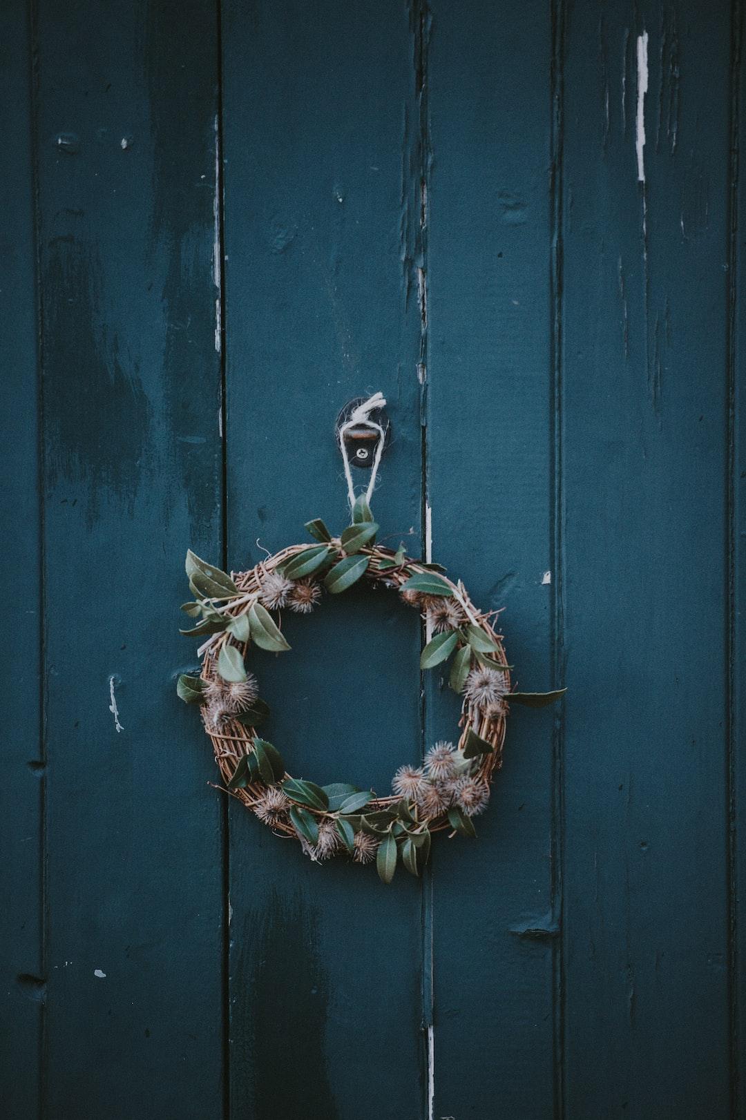 Homemade wreath on blue door