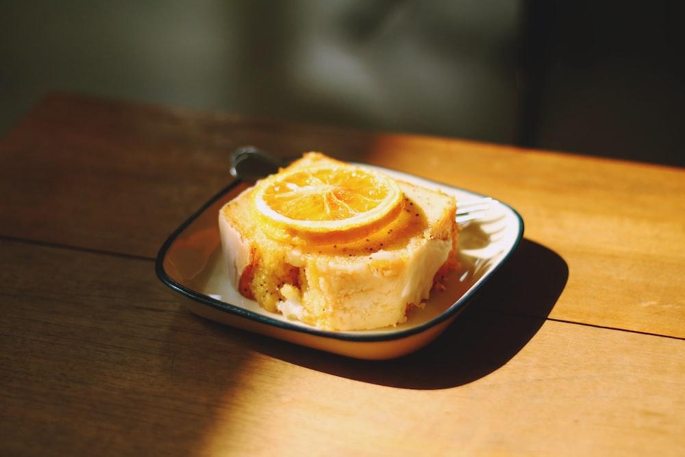 sliced lemon on top of sliced cake on white ceramic plate