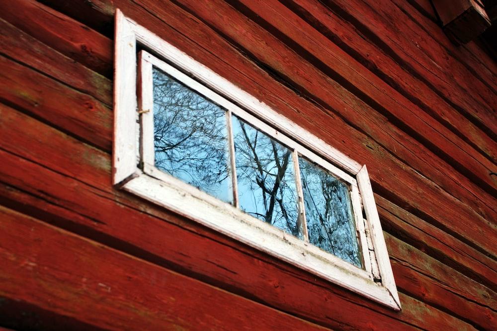 white wooden framed glass window pane