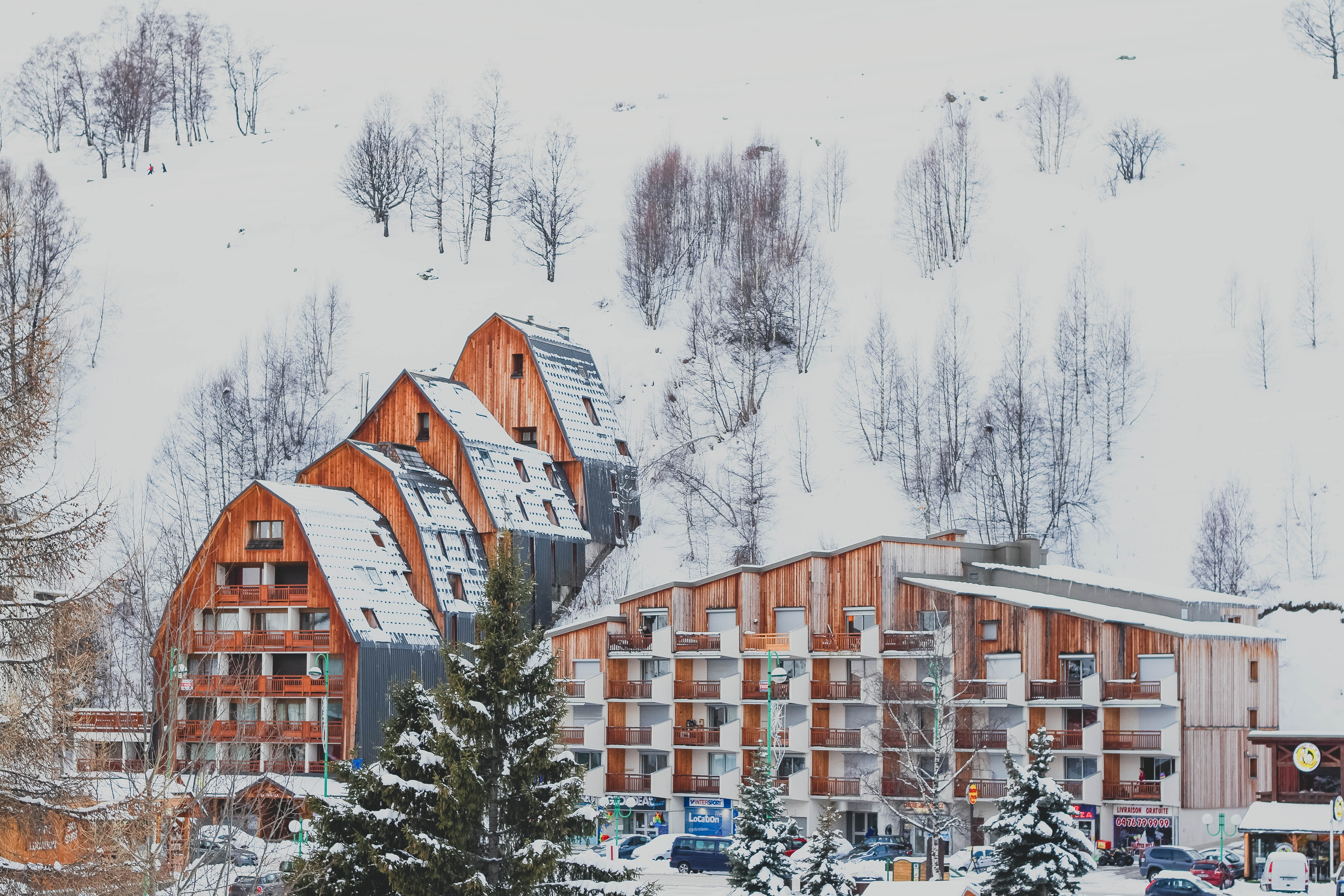 snow covers building on mountain